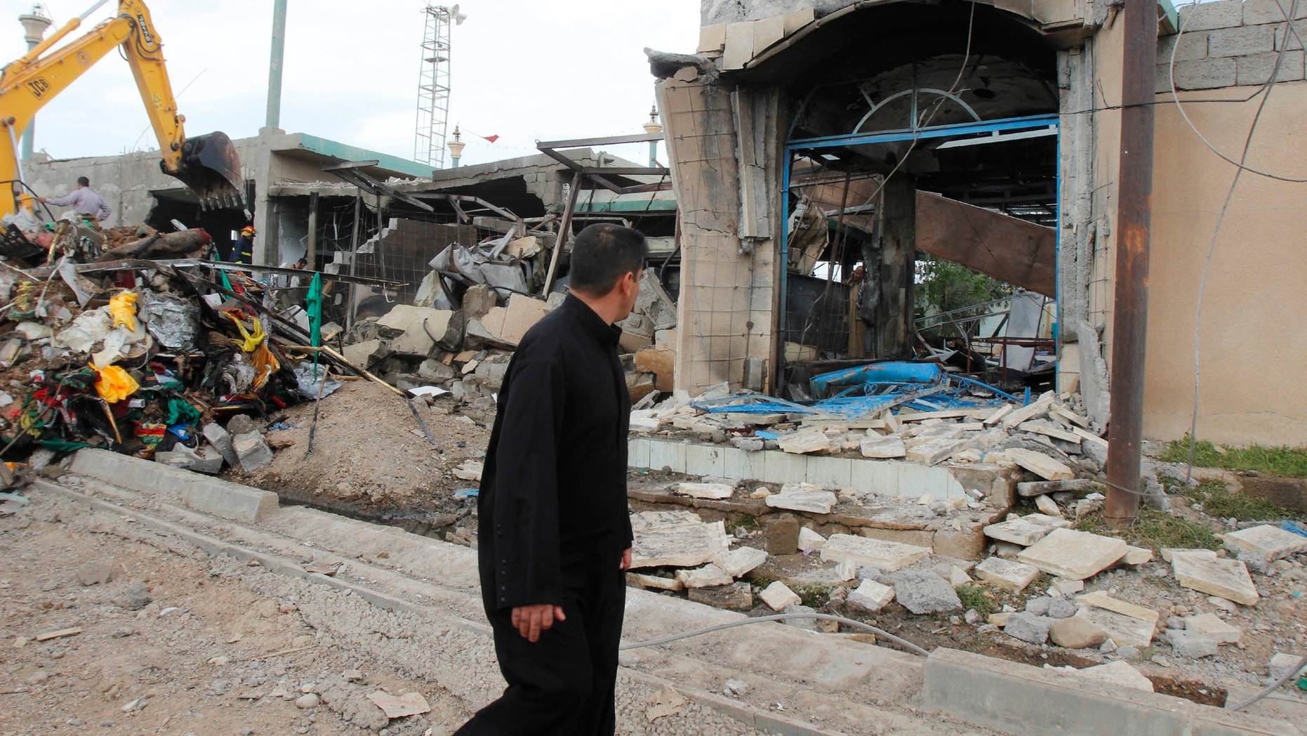 March 29, 2013 - A man looks at the site of a bomb attack in Kirkuk, 155 miles north of Baghdad.