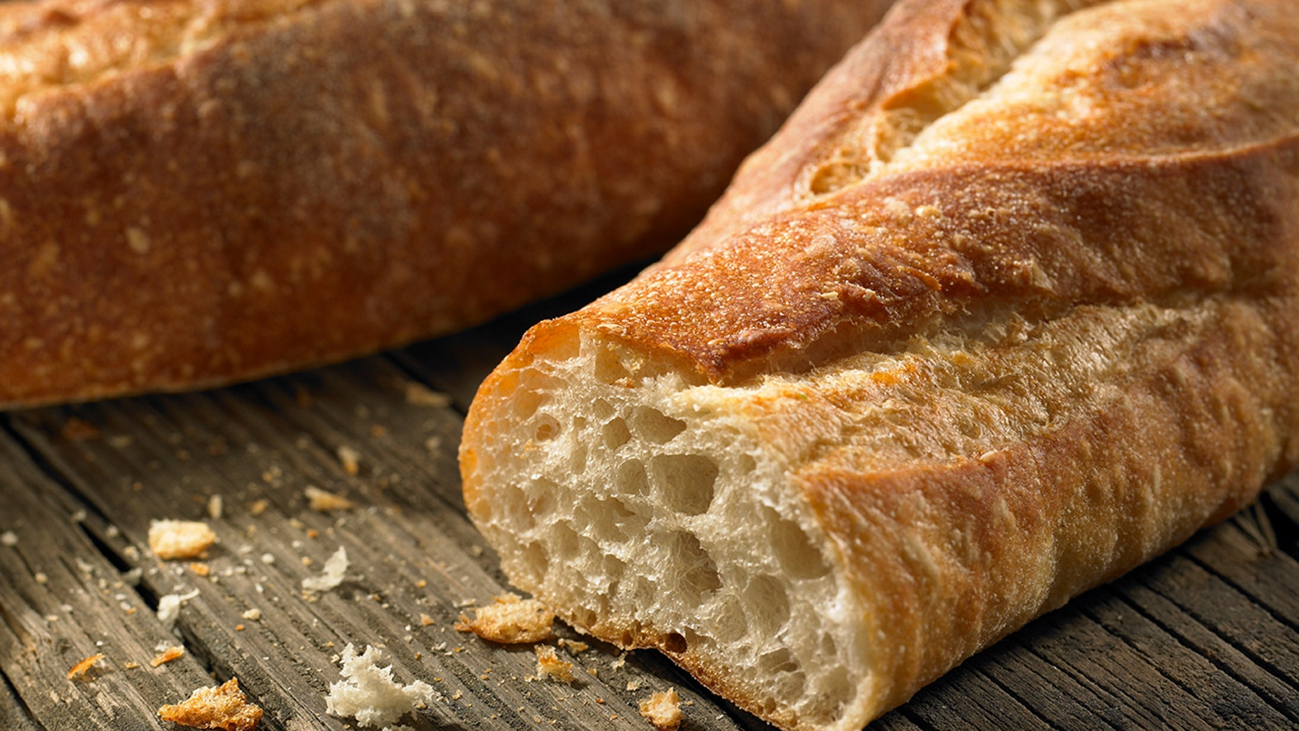 An angry customer beat a supermarket employee in the face with French bread