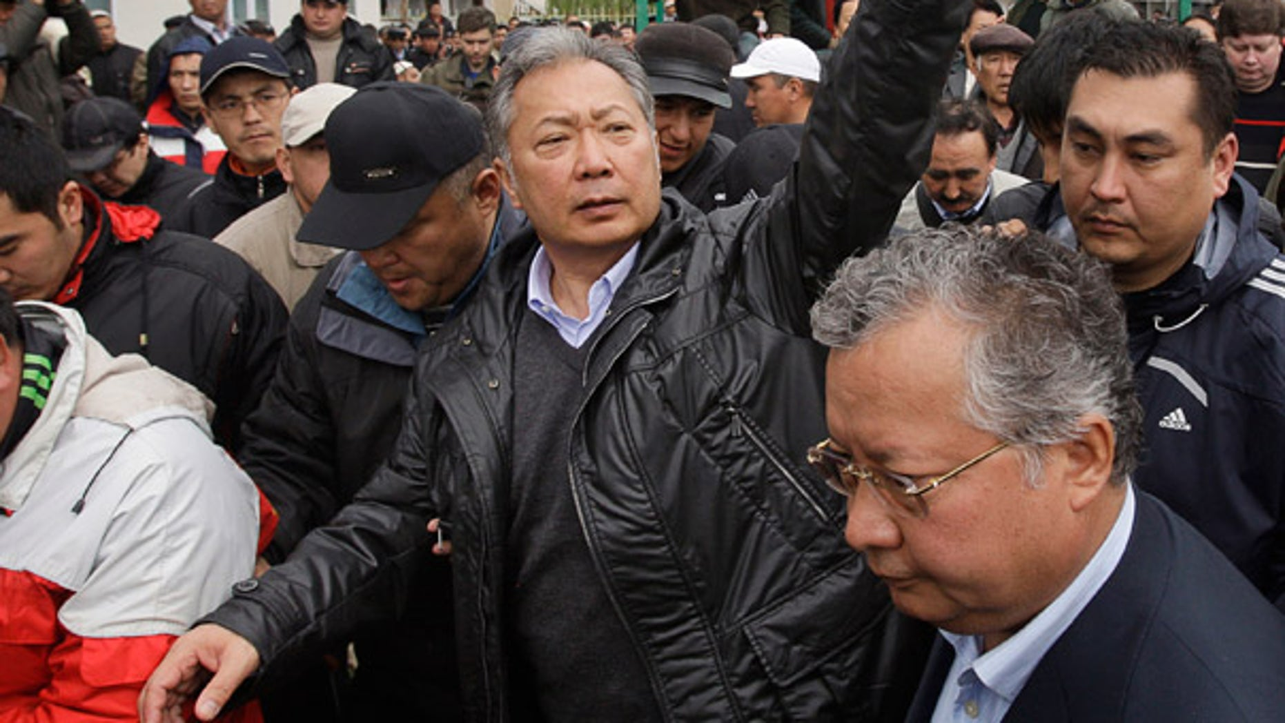 April 12: Kyrgyzstan's deposed President Kurmanbek Bakiyev greets supporters after a rally in the village of Teyit.
