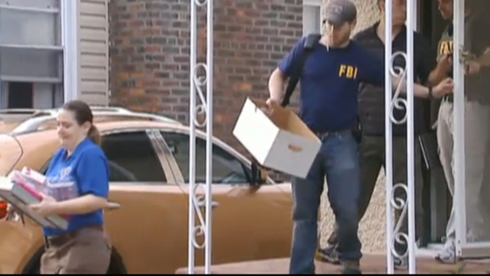 July 19, 2011: FBI agents execute a search warrant at the Long Island, NY, home of a suspected member of notorious hacking group Anonymous.