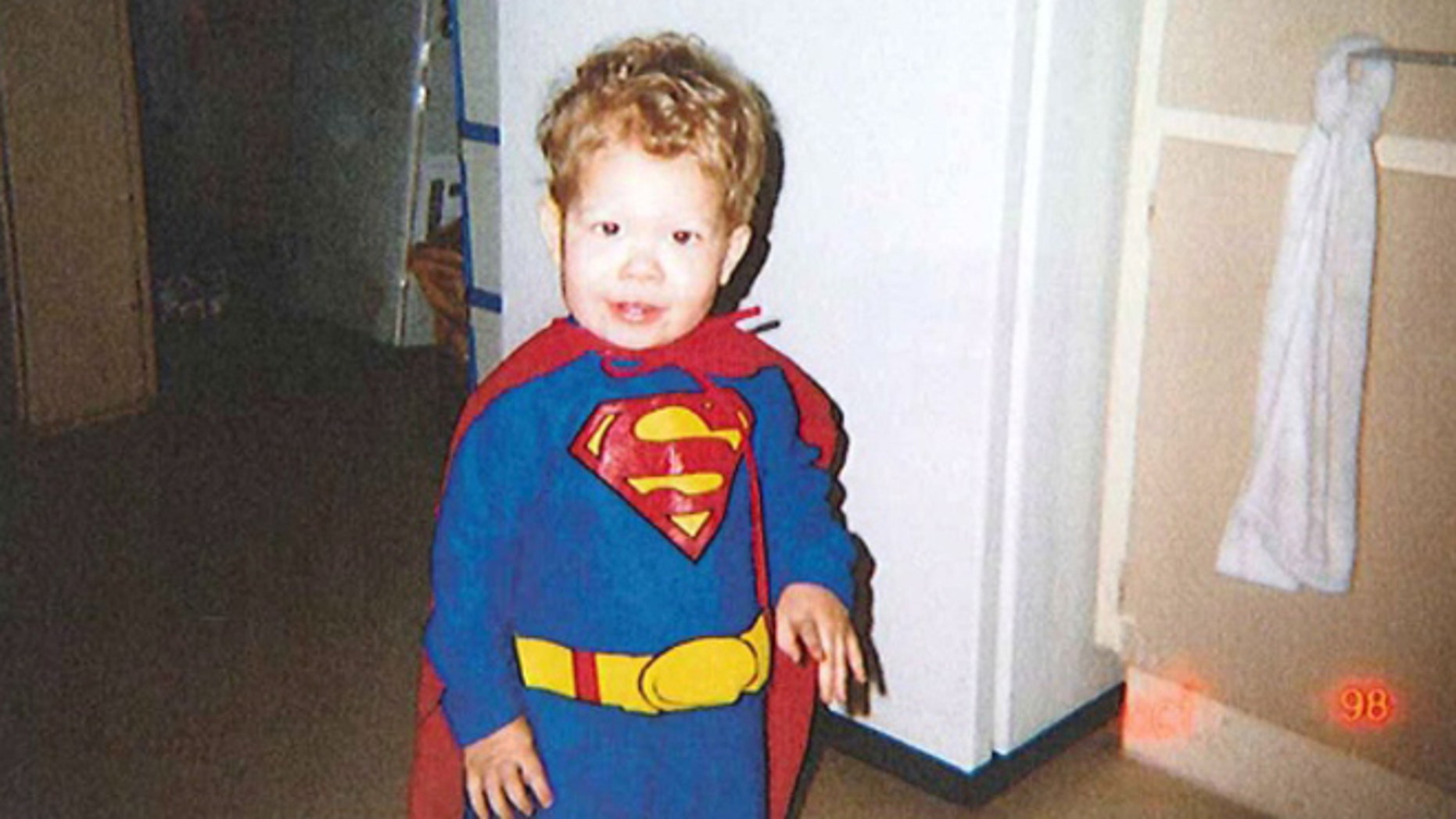 Jeffrey Baldwin is seen in a Halloween costume in this undated handout photo released at the inquest into his death last year. DC Entertainment is reportedly refusing to allow a memorial statue of Baldwin to feature the logo.
