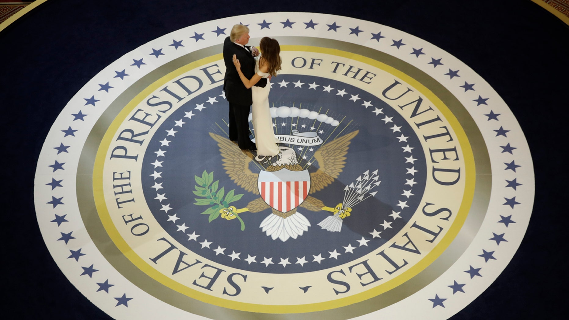 In this Jan. 20, 2017, file photo, President Donald Trump dances with first lady Melania Trump, at The Salute To Our Armed Services Inaugural Ball in Washington.