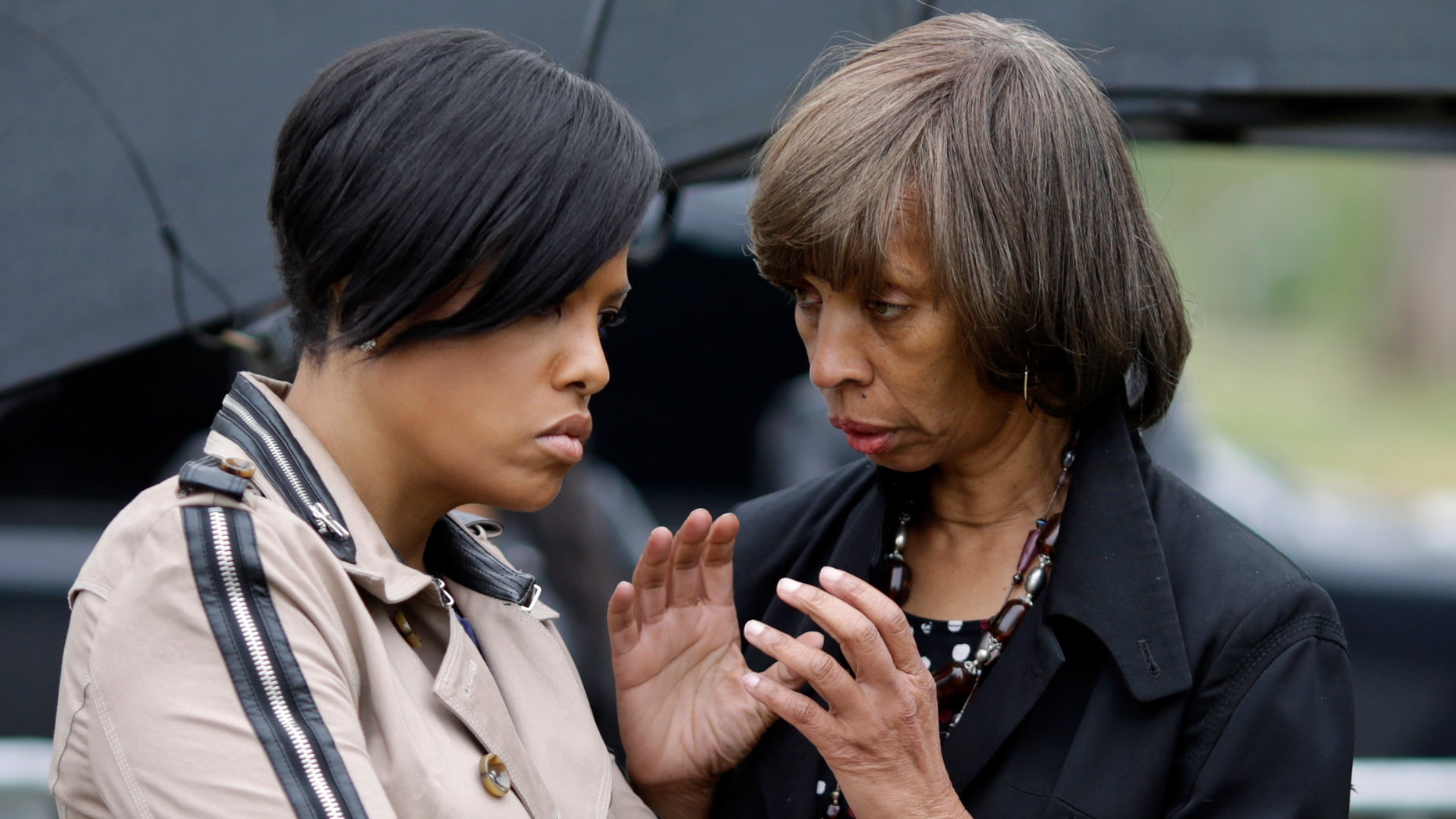 """Wednesday, April 27, 2016: Baltimore Mayor Stephanie Rawlings-Blake, left, listens to Sen. Catherine Pugh, D-Baltimore, during a """"Day of Reconciliation"""" event in Baltimore, the first anniversary of rioting following the funeral of Freddie Gray."""