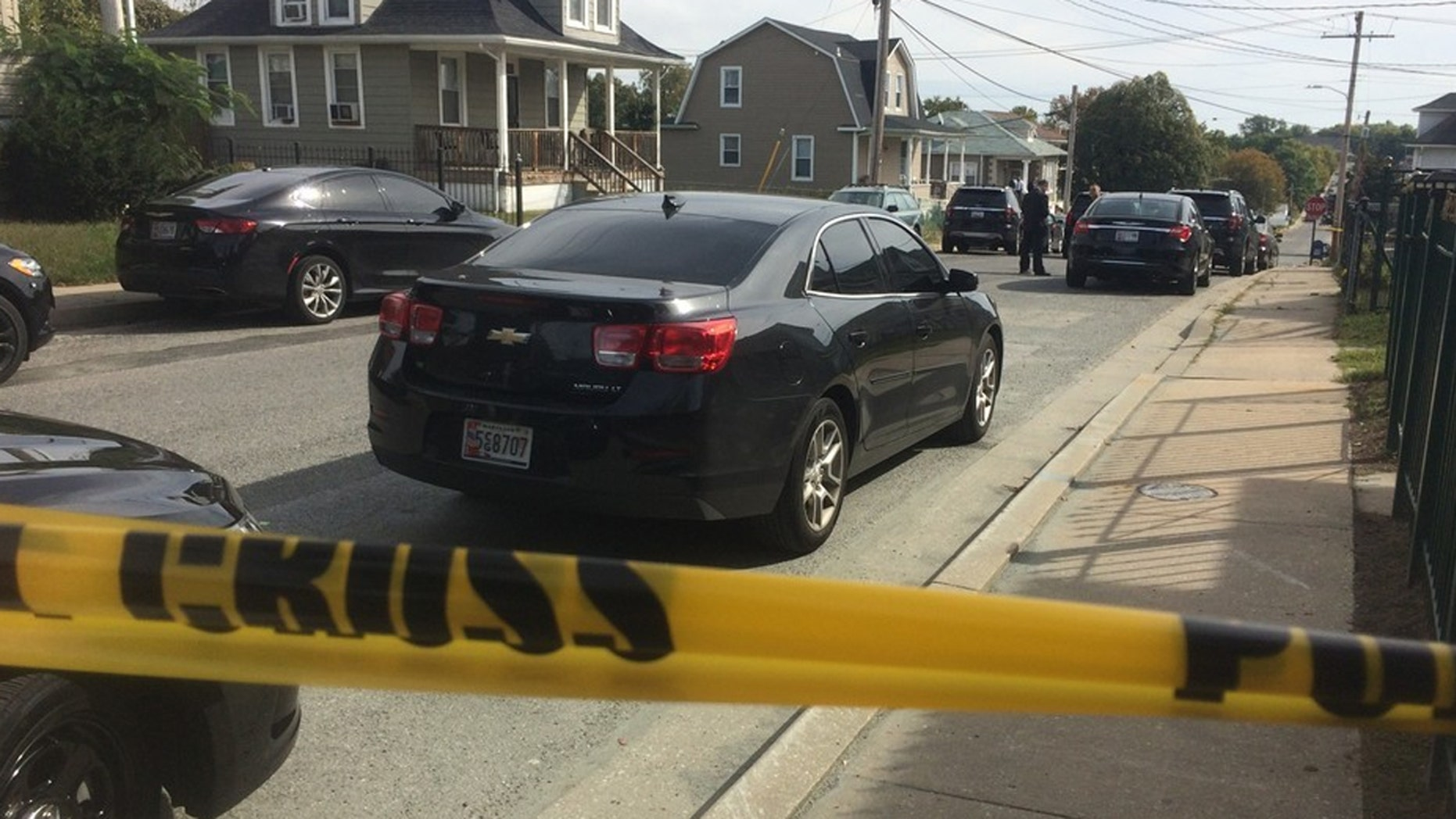 An off-duty Baltimore police officer shot an intruder in his home, officials said.