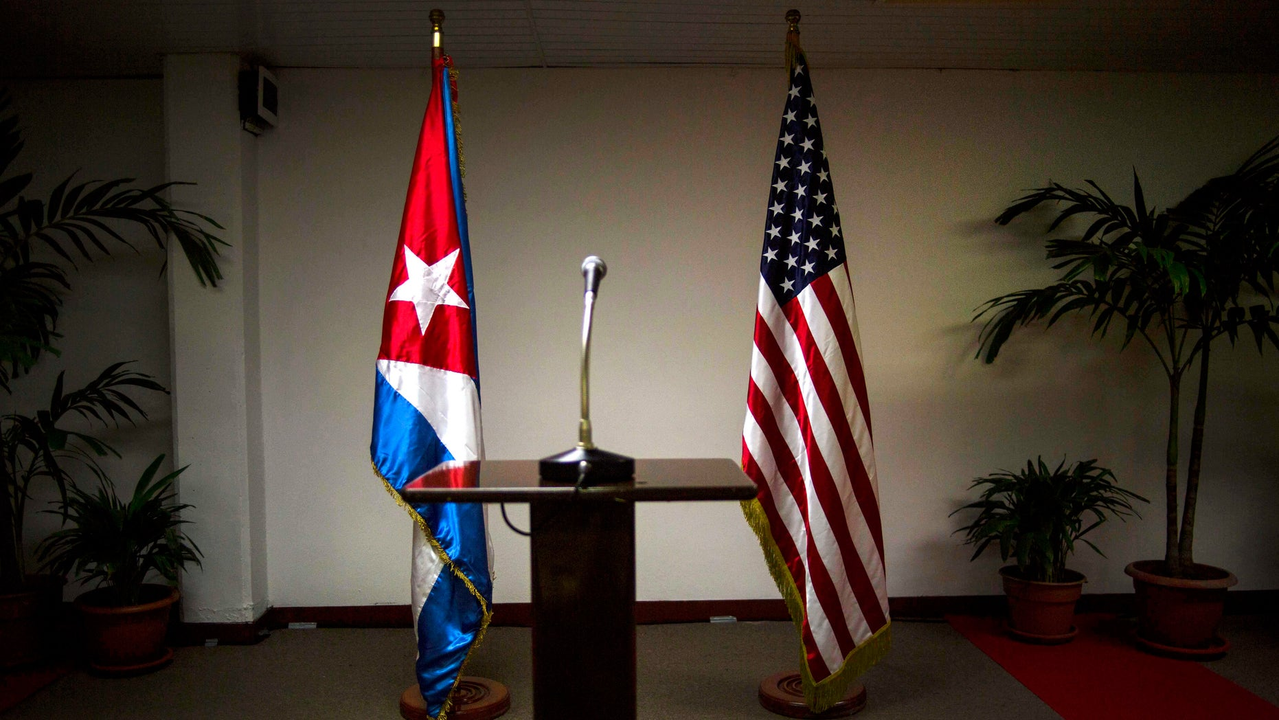 FILE - In this Jan. 22, 2015 file photo, a Cuban and U.S. flag stand before the start of a press conference on the sidelines of talks between the two nations in Havana, Cuba. The U.S. hopes to open an embassy in Havana before presidents Barack Obama and Raul Castro meet at a regional summit in April, which will be the scene of the presidents' first face-to-face meeting since they announced on Dec. 17 that they will re-establish diplomatic relations after a half-century of hostility. (AP Photo/Ramon Espinosa, File)