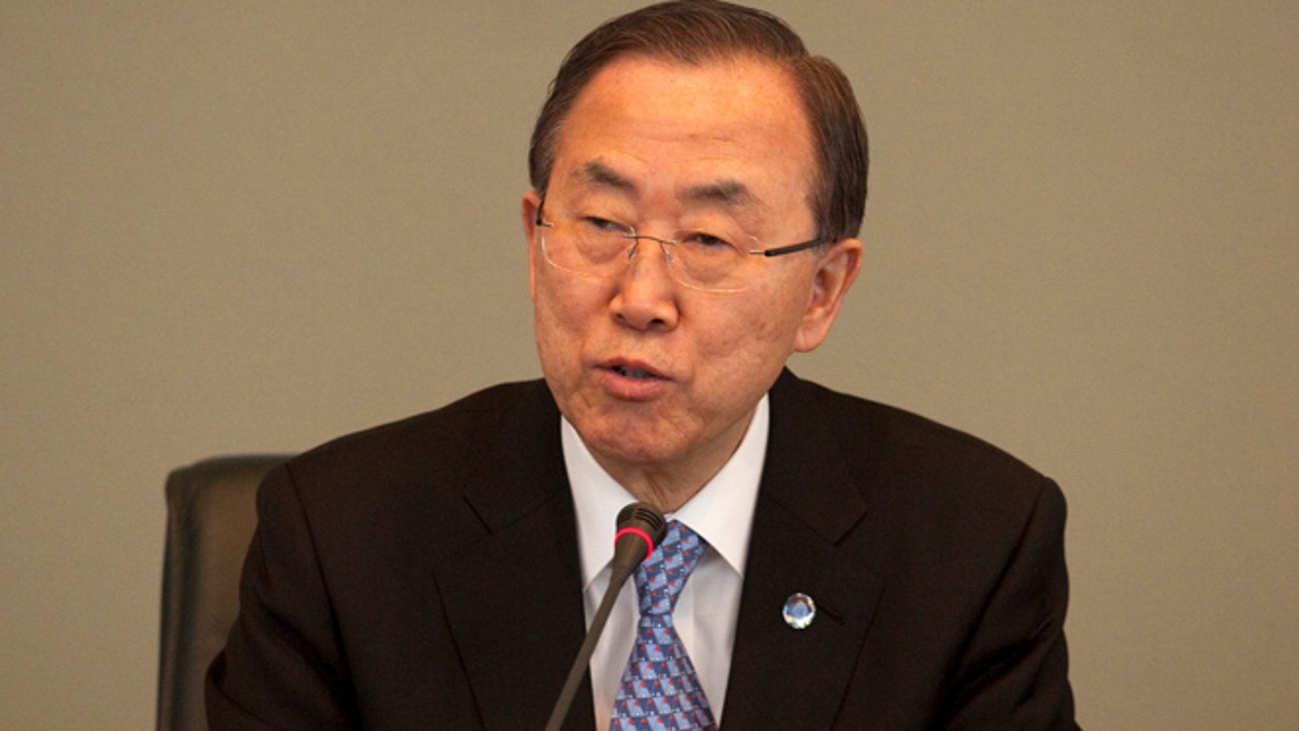 April 8, 2013: U.N. Secretary-General Ban Ki-moon, left, speaks at the headquarters of the Organization for the Prohibition of Chemical Weapons (OPCW) in The Hague, Netherlands.  Ban Ki-moon says inspectors are ready to deploy to Syria within 24 hours to investigate reported chemical weapon attacks in the country's two-year civil war but have no permission yet from President Bashar Assad's government.