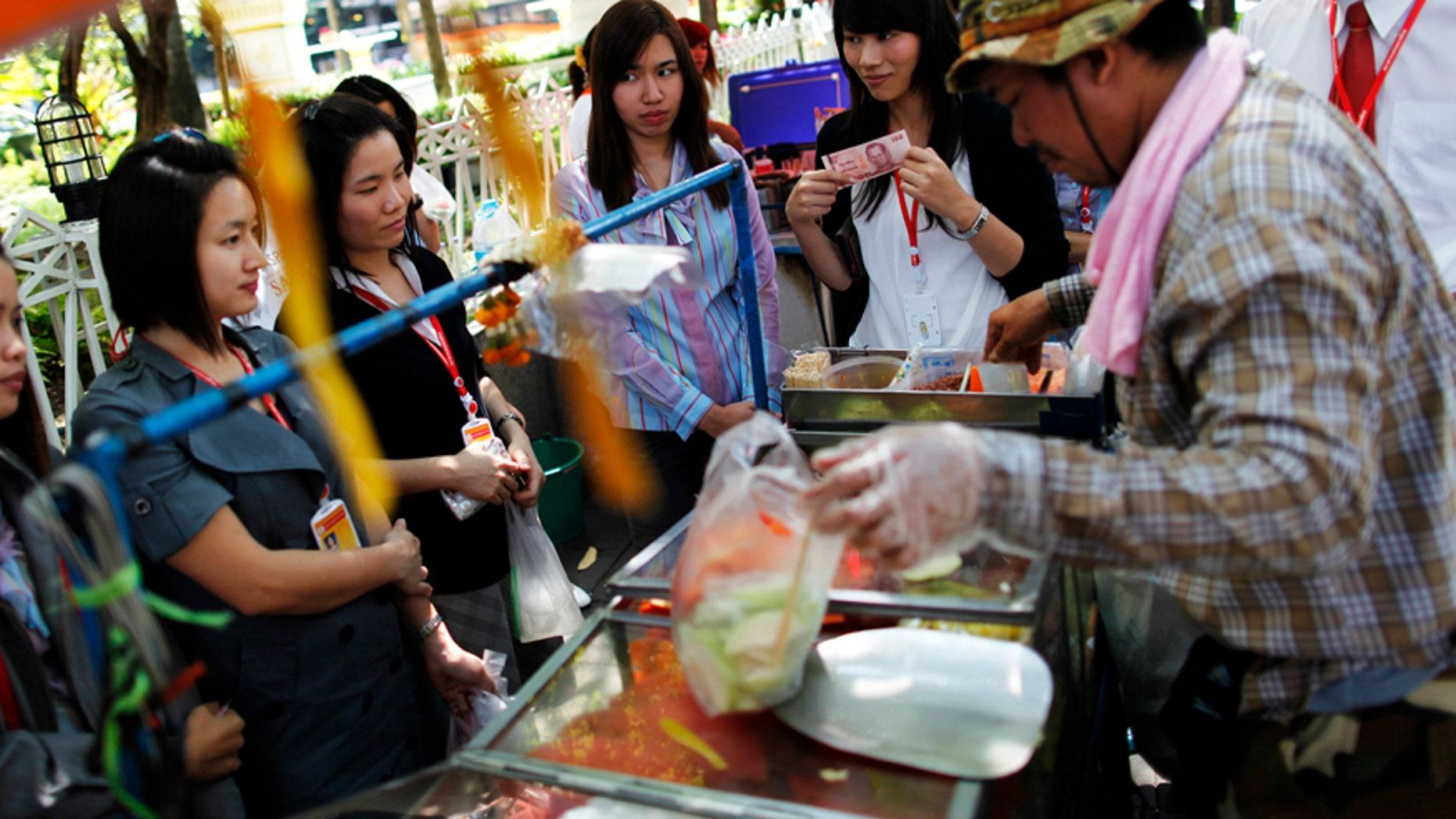 Street vendors hawk their wares in Bangkok, Thailand.
