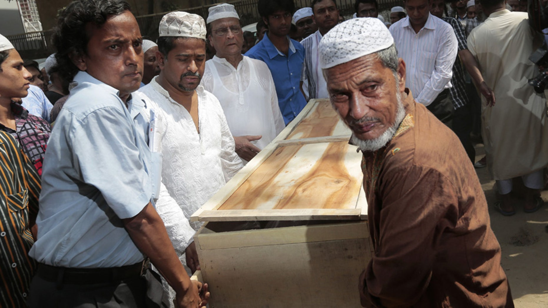 April 26, 2016: Bangladeshi Muslims carry the body of Xulhaz Mannan who was stabbed to death by unidentified assailants for his funeral in Dhaka, Bangladesh.