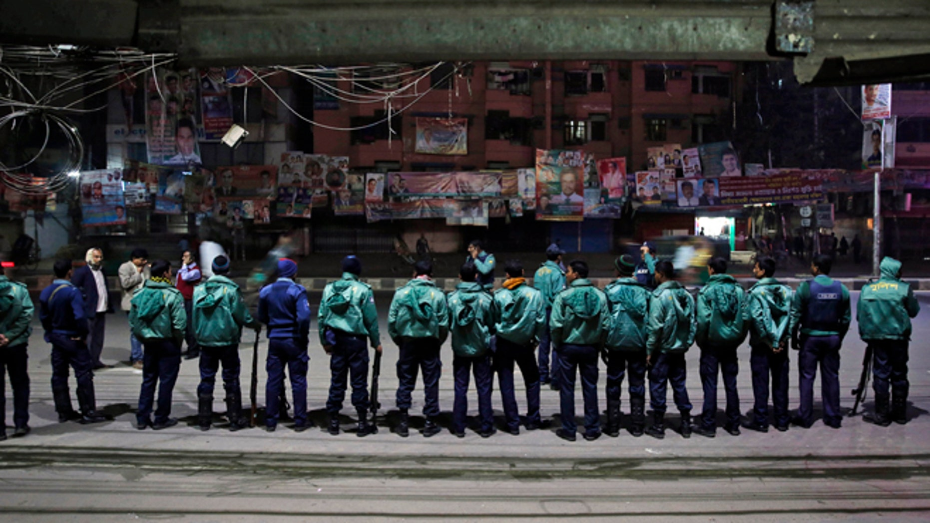Jan. 4, 2013: Bangladeshi policemen stand guard outside the office of the main opposition Bangladesh Nationalist Party (BNP) during a nationwide 48-hour strike called by them a day ahead of general elections in Dhaka, Bangladesh.