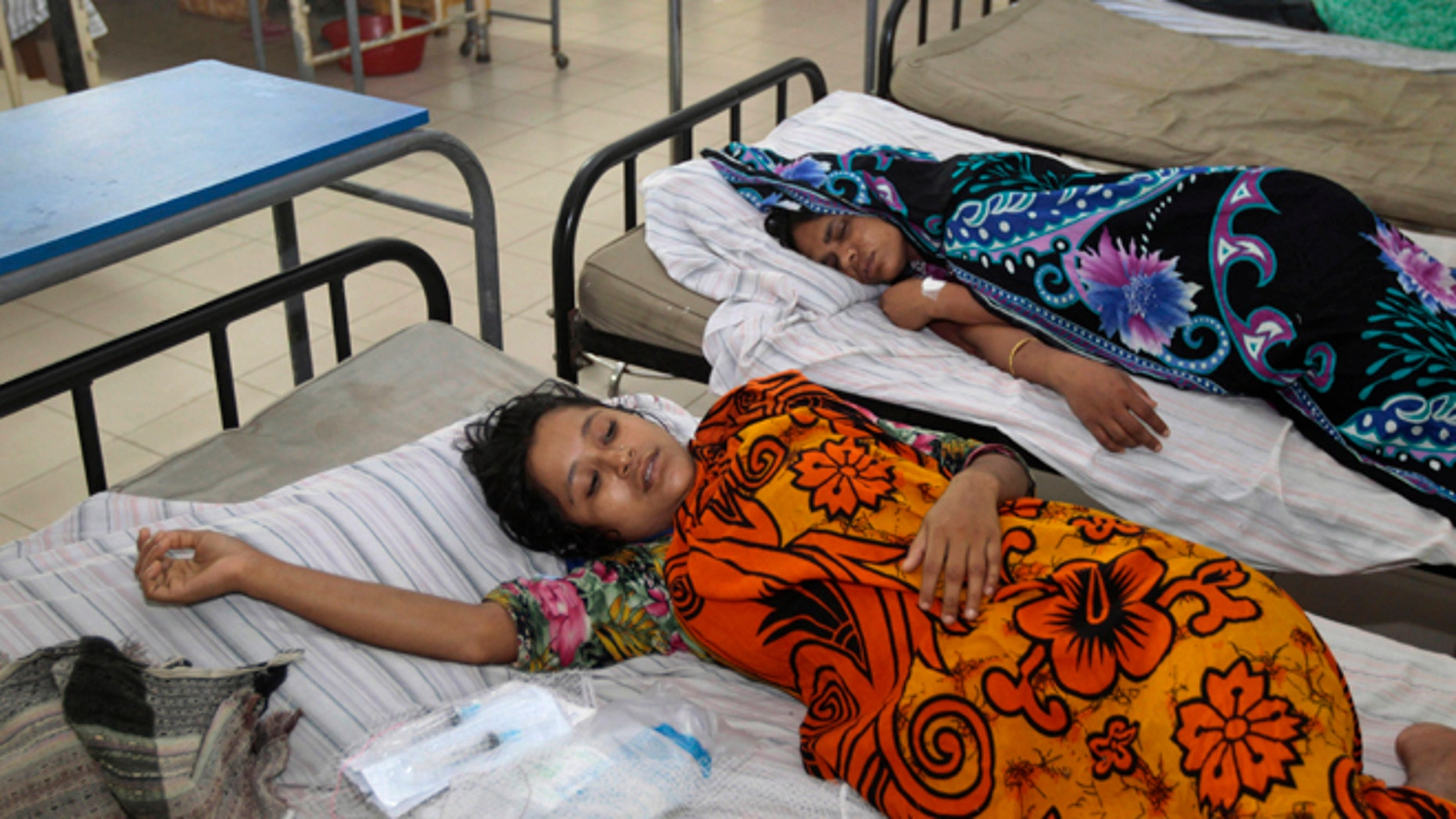 June 6, 2013: Bangladeshi garment workers who fell ill during their shifts at a sweater factory lie on beds at a hospital on the outskirts of Dhaka, Bangladesh. About 450 garment workers fell ill at the Starlight Sweater Factory near Bangladesh's capital, due to possible water contamination. A building collapse near Dhaka in April killed 1,129 workers, injured others and highlighted the hazardous working conditions in thousands of garment factories in Bangladesh.