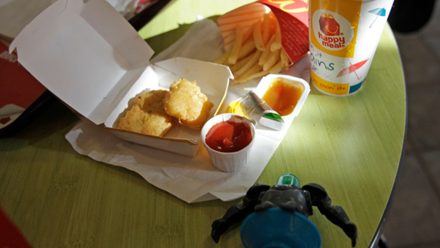 Shown is a Happy Meal at a McDonald's restaurant in San Francisco, Monday, Nov. 8, 2010. In the foreground is a character toy included with the meal from the movie Megamind. It is a happy moment for people who see the Happy Meal as anything but.  San Francisco is poised to become the first major American city to require fast-food restaurants to sell meals that meet set nutritional guidelines or not include a toy with them. (AP Photo/Eric Risberg)