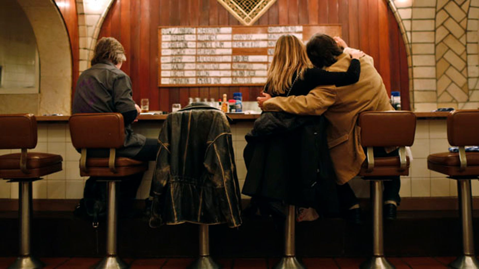 Customers sit at the counter of the Oyster bar in the lower level of Grand Central Terminal in New York, January 29, 2013.