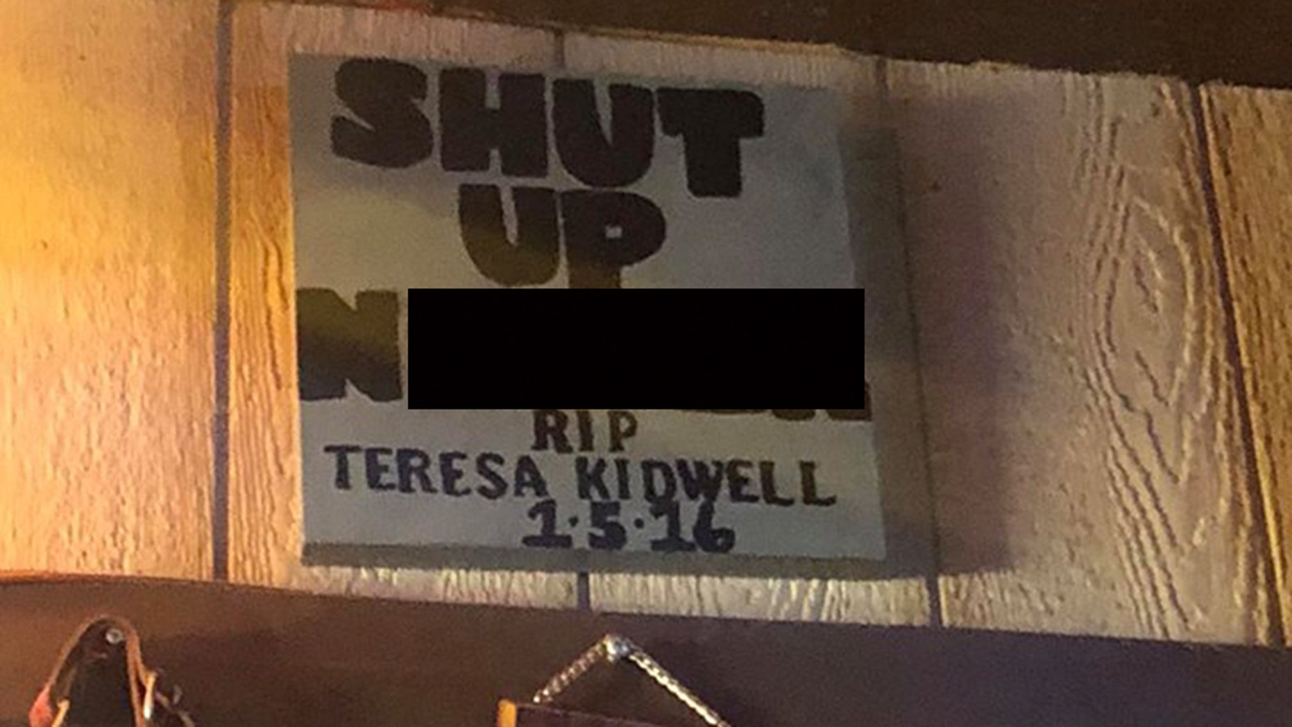 A bar in Texas has removed a sign with a racial slur after two patrons complained on social media.