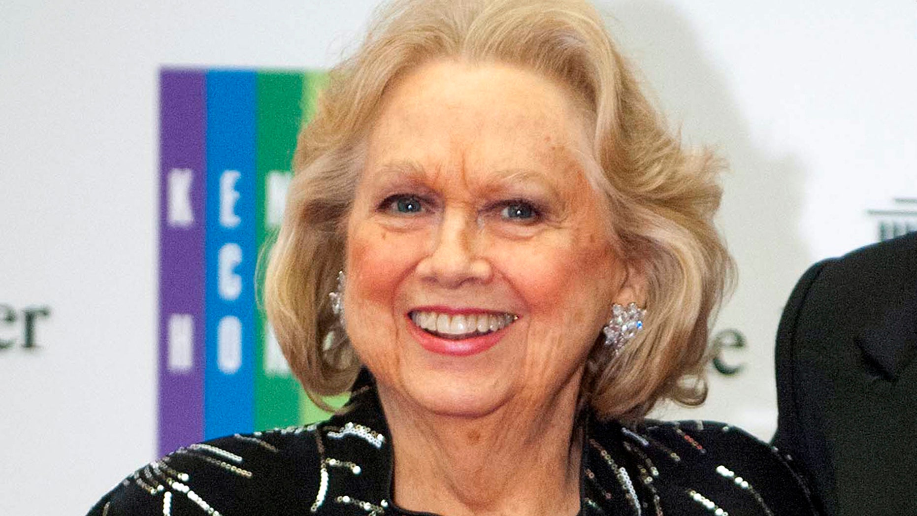 In this Dec. 7, 2013 file photo, Barbara Cook arrives at the State Department for the Kennedy Center Honors gala dinner in Washington. Cook, whose shimmering soprano made her one of Broadway's leading ingenues and later a major cabaret and concert interpreter of popular American song, has died.