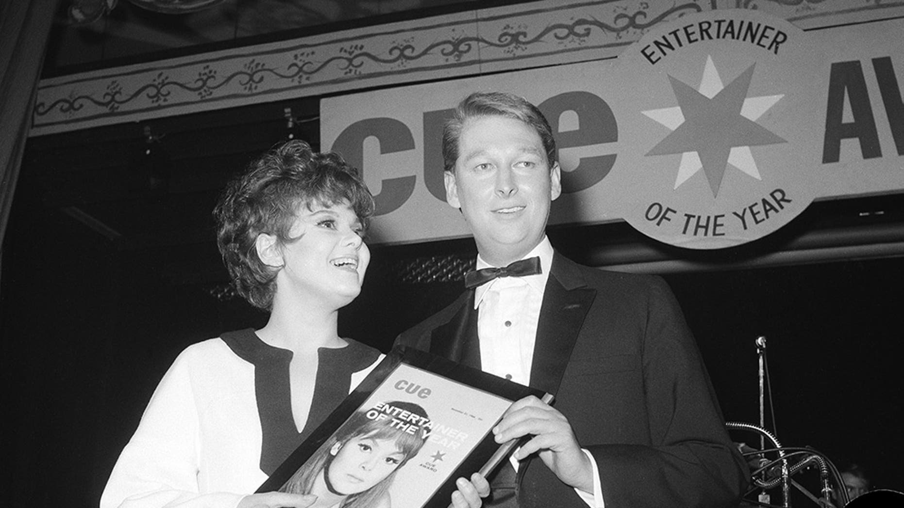 """FILE - In this Jan. 4, 1967 file photo, Barbara Harris, star of """"The Apple Tree"""" receives Cue Magazine's """"Entertainer of the Year"""" award from last year's winner, director Mike Nichols in New York. Harris, the Tony-winning actress whose intelligence, impish good looks and winsomely neurotic manner brightened Broadway musicals in the '60s and films such as """"Nashville,"""" """"Freaky Friday"""" and """"A Thousand Clowns"""" has died. She was 83."""