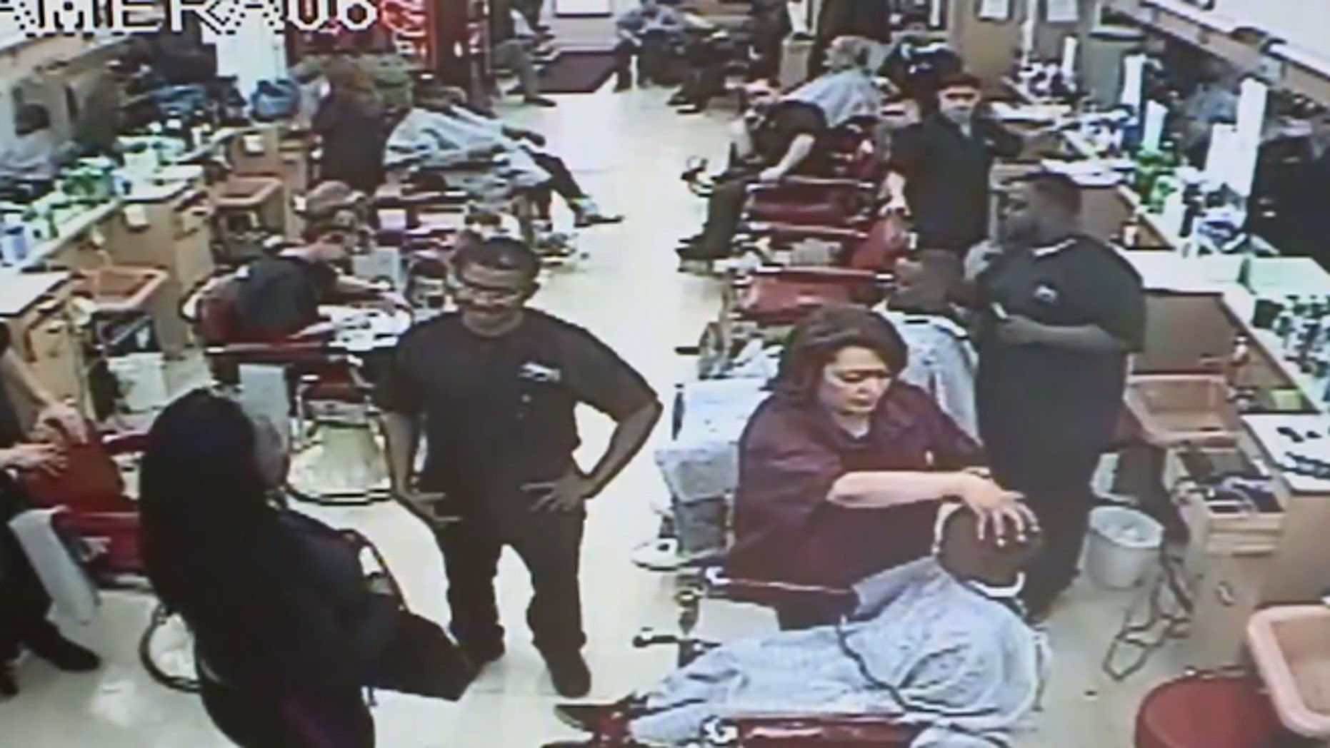Cleveland police are seeking to identify a woman who pulled a gun on a barber because her son's $6 haircut was taking too long.