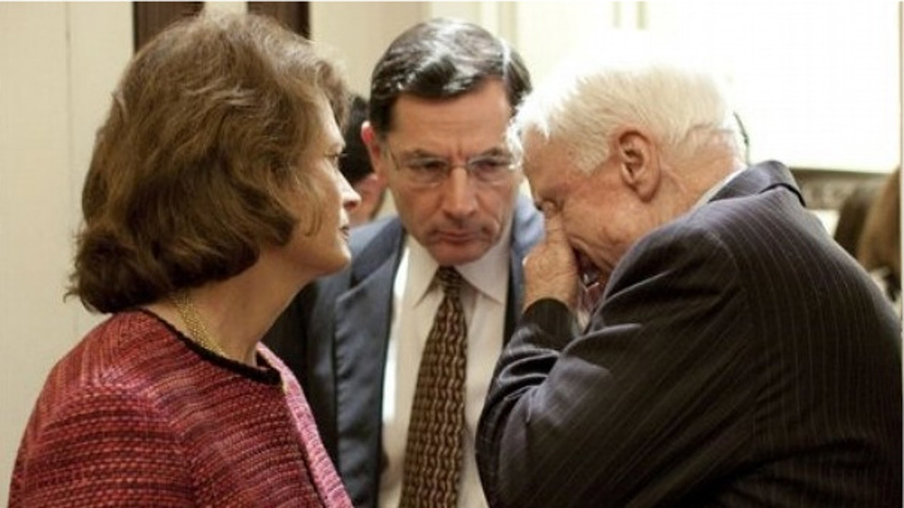 Dec. 9: Sen. John Barrasso, R-Wyo., talks with Alaska Sen. Lisa Murkowski and Arizona Sen. John McCain in a Senate hallway. (AP)