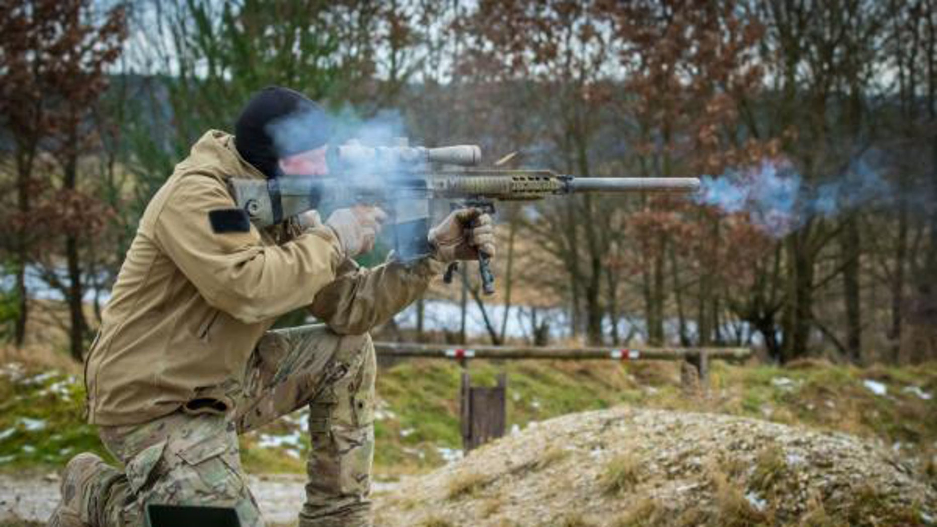 A U.S. Army Special Forces Soldier assigned to 10th Special Forces Group (Airborne) fires an M110 Semi-Automatic Sniper System during weapons training in Grafenwoehr, Germany, Dec., 12, 2017. (Photo by Staff Sgt. Jessica Nassirian/U.S. Army)