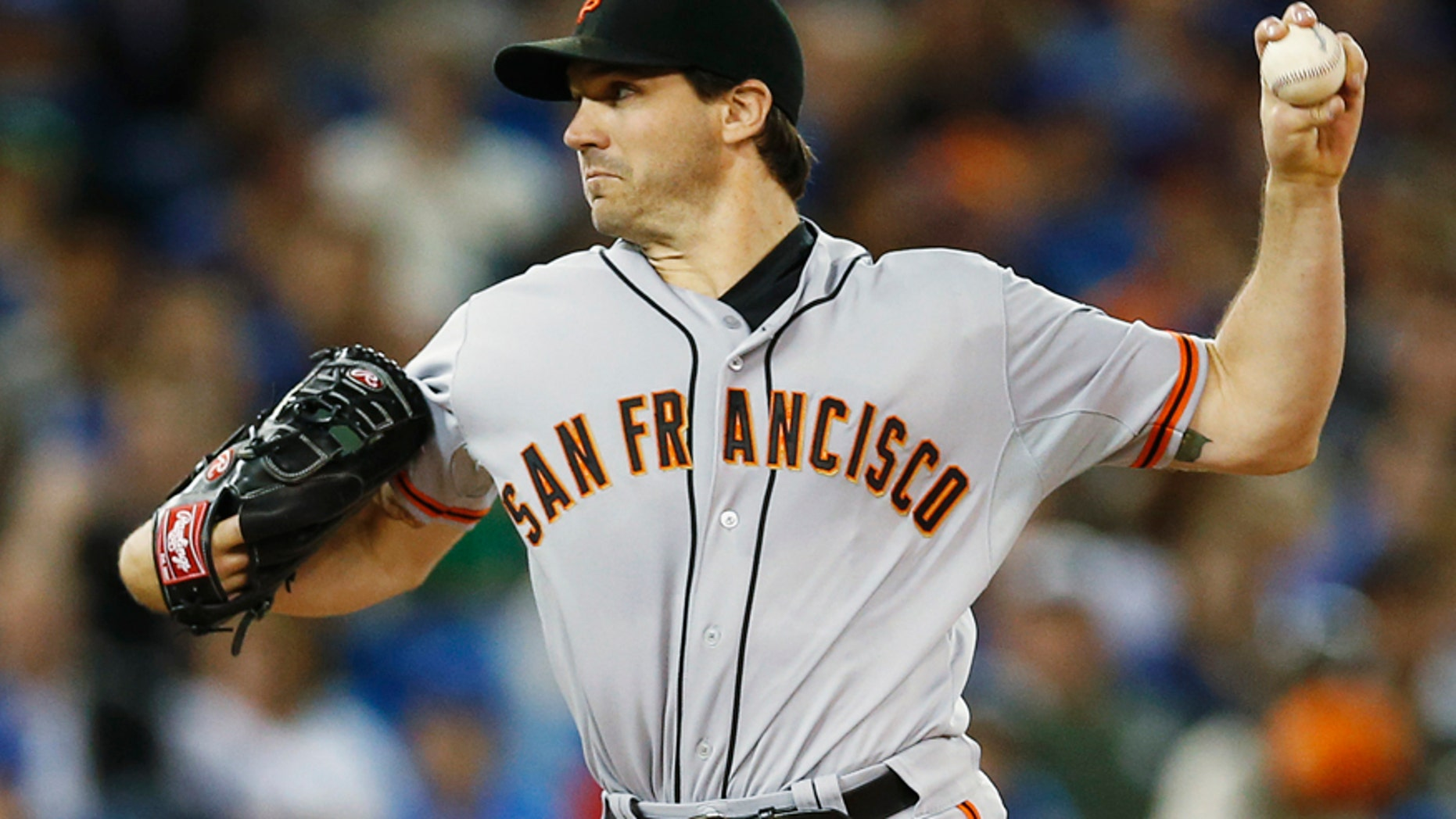 San Francisco Giants pitcher Barry Zito pitches to the Toronto Blue Jays during the first inning of their MLB American League baseball game in Toronto, May 14, 2013.