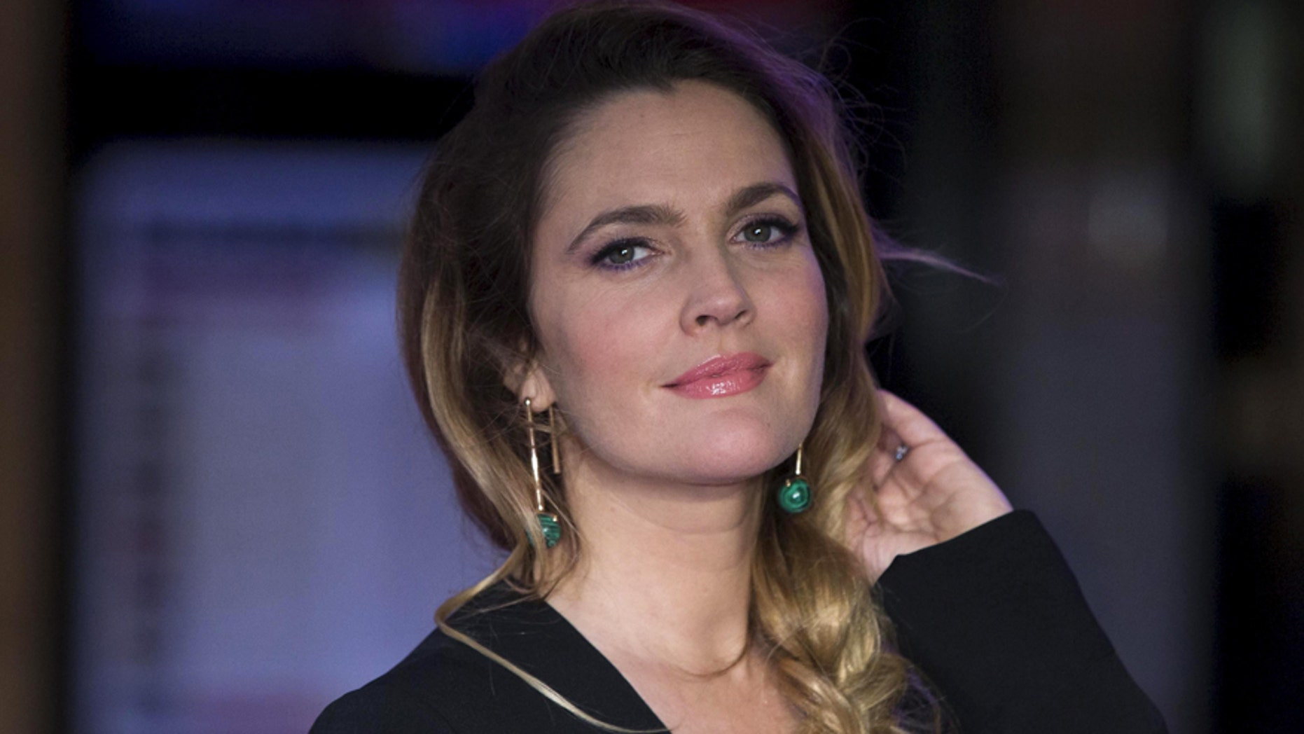 "Drew Barrymore poses for photographers at the European premiere of the film ""Miss You Already"""
