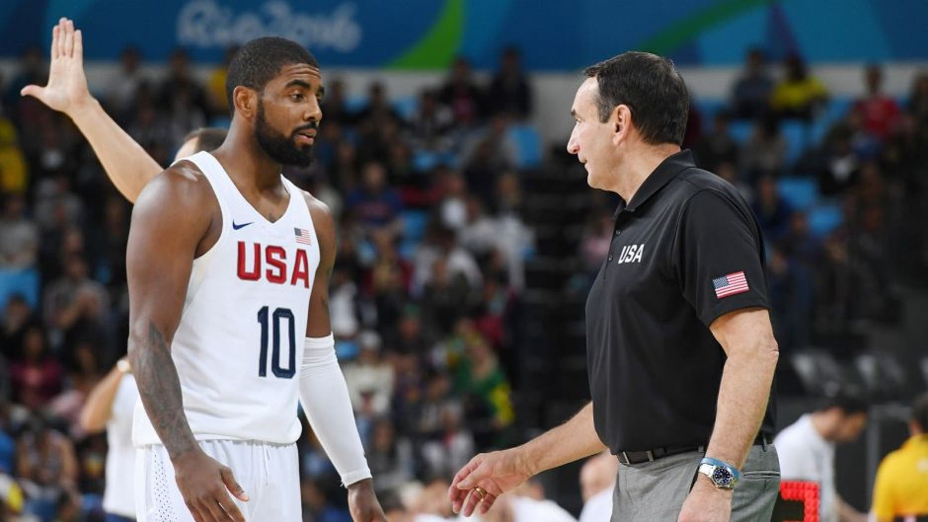 RIO DE JANEIRO, BRAZIL - AUGUST 12: Kyrie Irving #10 and head coach Mike Krzyzewski of the USA Basketball Men's National Team talk during the game against Serbia on Day 7 of the Rio 2016 Olympic Games at Carioca Arena 1 on August 12, 2016 in Rio de Janeiro, Brazil. NOTE TO USER: User expressly acknowledges and agrees that, by downloading and/or using this Photograph, user is consenting to the terms and conditions of the Getty Images License Agreement. Mandatory Copyright Notice: Copyright 2016 NBAE (Photo by Garrett Ellwood/NBAE via Getty Images)