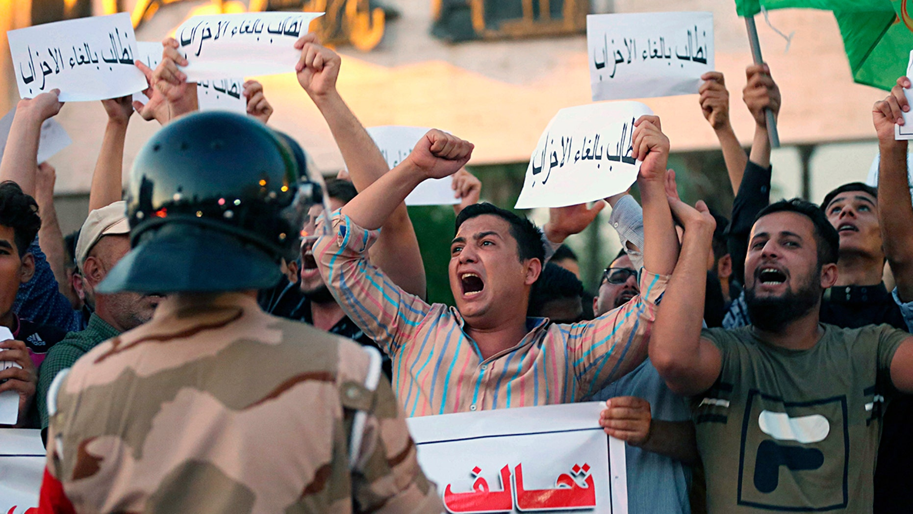 Iraqi protesters chant slogans demanding services and jobs during a demonstration in Tahrir Square, Baghdad, Iraq, July 14.