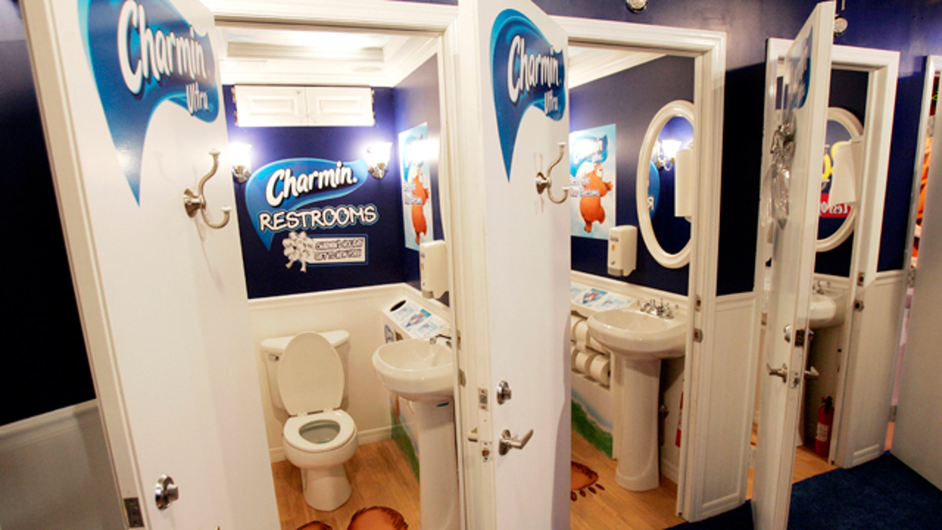 Three of 20 free public bathroom units that will be open for the holiday shopping season in New York's Times Square.