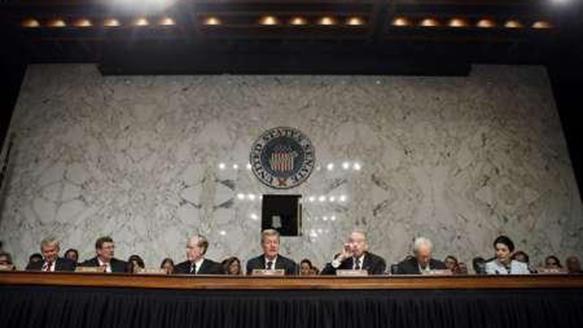Sen. Max Baucus, center, chairman of the Senate Finance Committee, speaks alongside other panel members before a health care vote in Washington Oct. 13. (Reuters Photo)