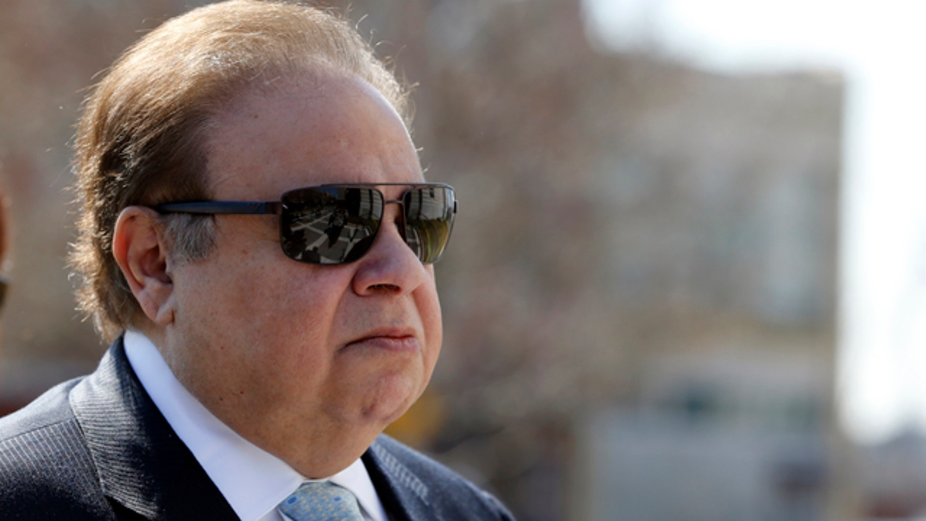 FILE - In this April 2, 2015, file photo, Dr. Salomon Melgen arrives at the Martin Luther King Jr. Federal Courthouse for his arraignment, in Newark, N.J. (AP Photo/Julio Cortez, File)