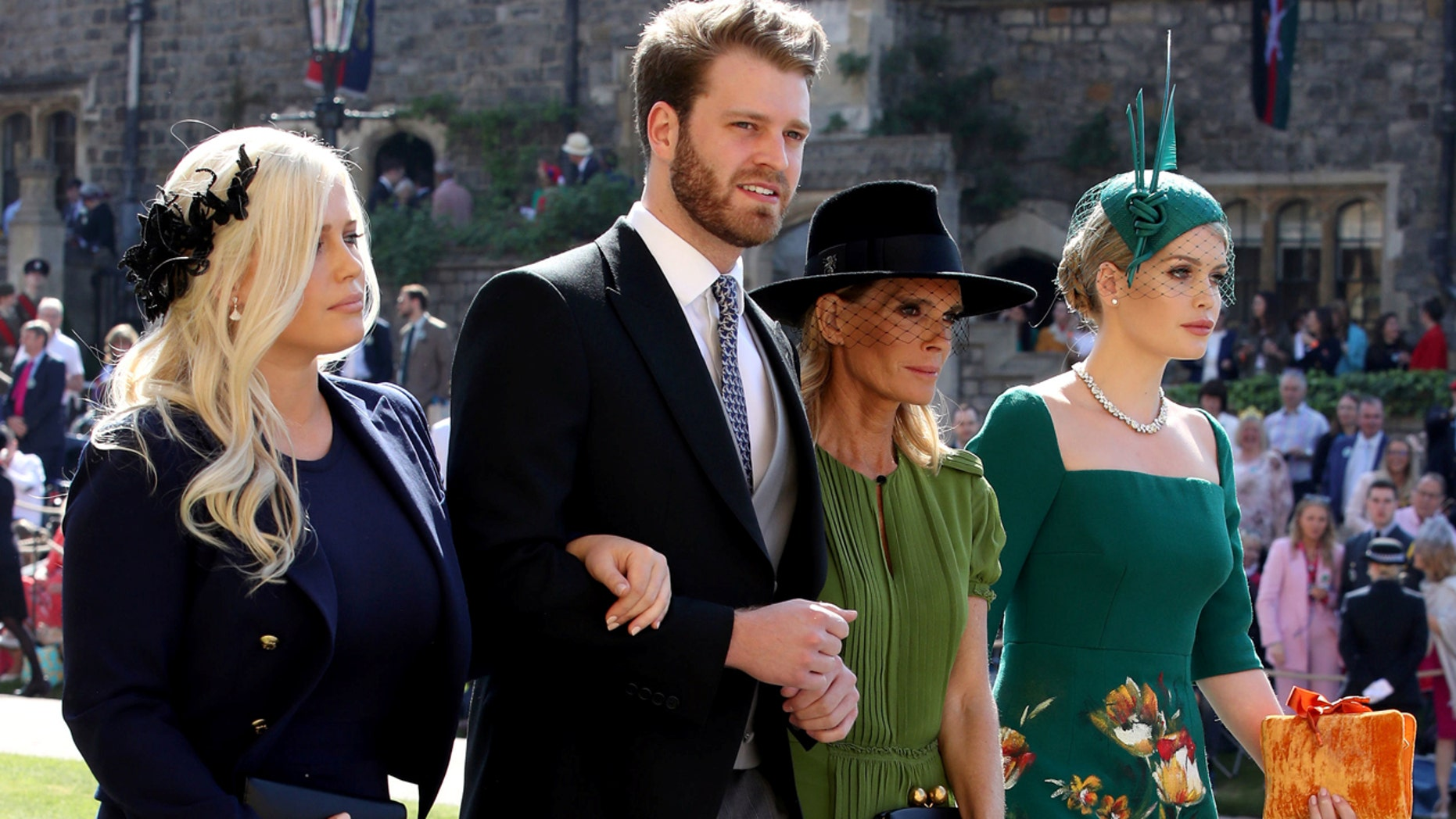The dashing Louis Spencer, cousin of Prince Harry, with his sisters Eliza and Kitty Spencer, and their mother, Victoria Aitken, to the royal wedding.