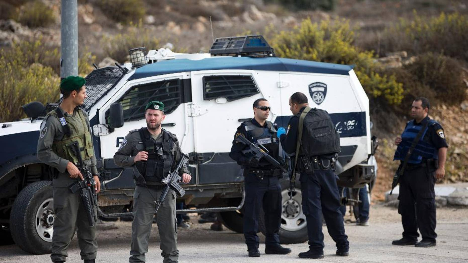 Israeli border police officers secure a checkpoint near the West Bank town of Nablus, Friday, Oct. 30, 2015. (AP Photo/Ariel Schalit)