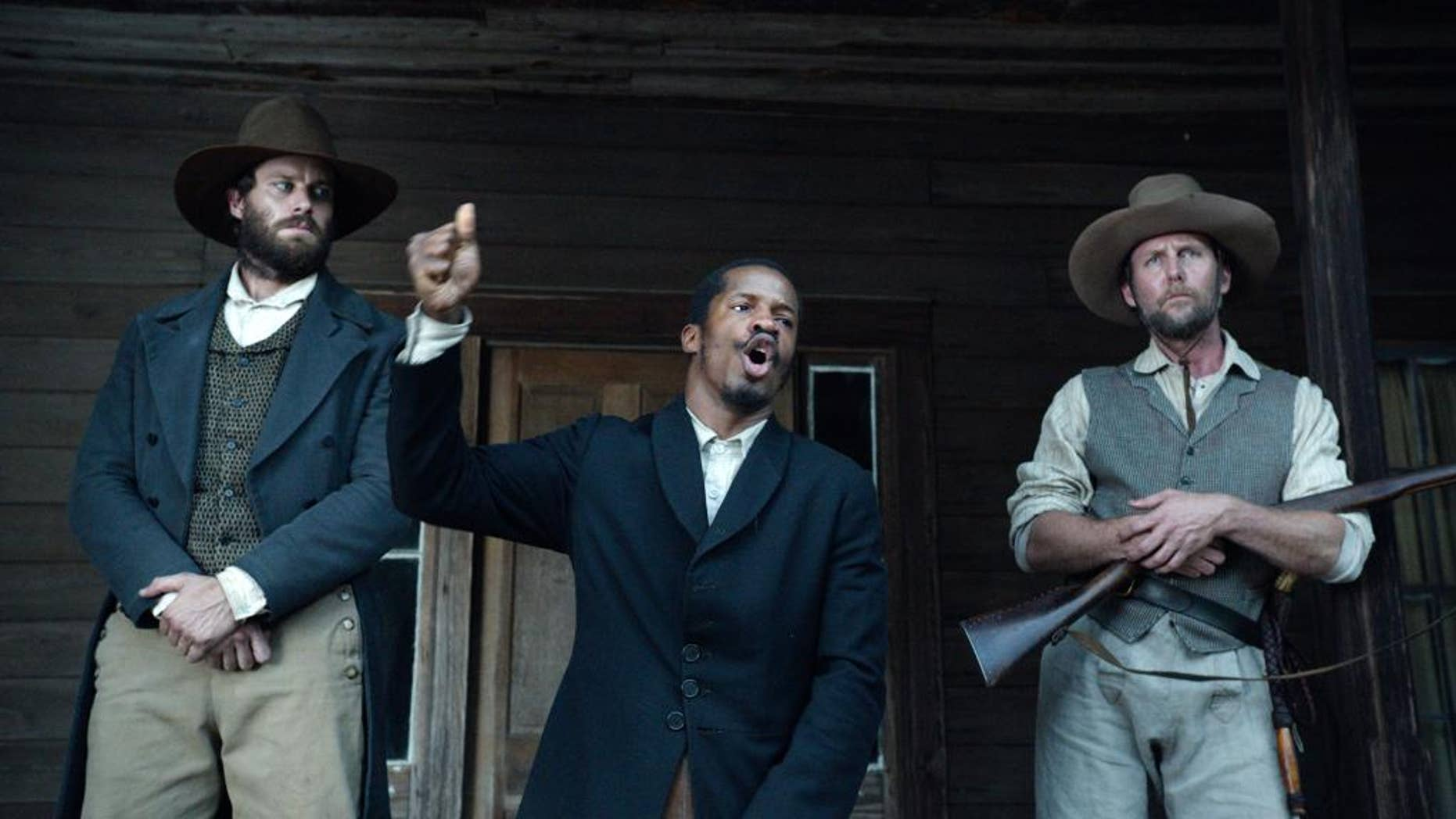 """In this image released by Fox Searchlight Pictures, from left, Armie Hammer portrays Samuel Turner, Nate Parker portrays Nat Turner and Jayson Warner Smith portrays Earl Fowler in a scene from """"The Birth of a Nation,"""" opening Oct. 7, 2016. Parker said he hopes the movie will inspire people to challenge injustices worldwide and said the lecture series would help. (Fox Searchlight Pictures via AP)"""