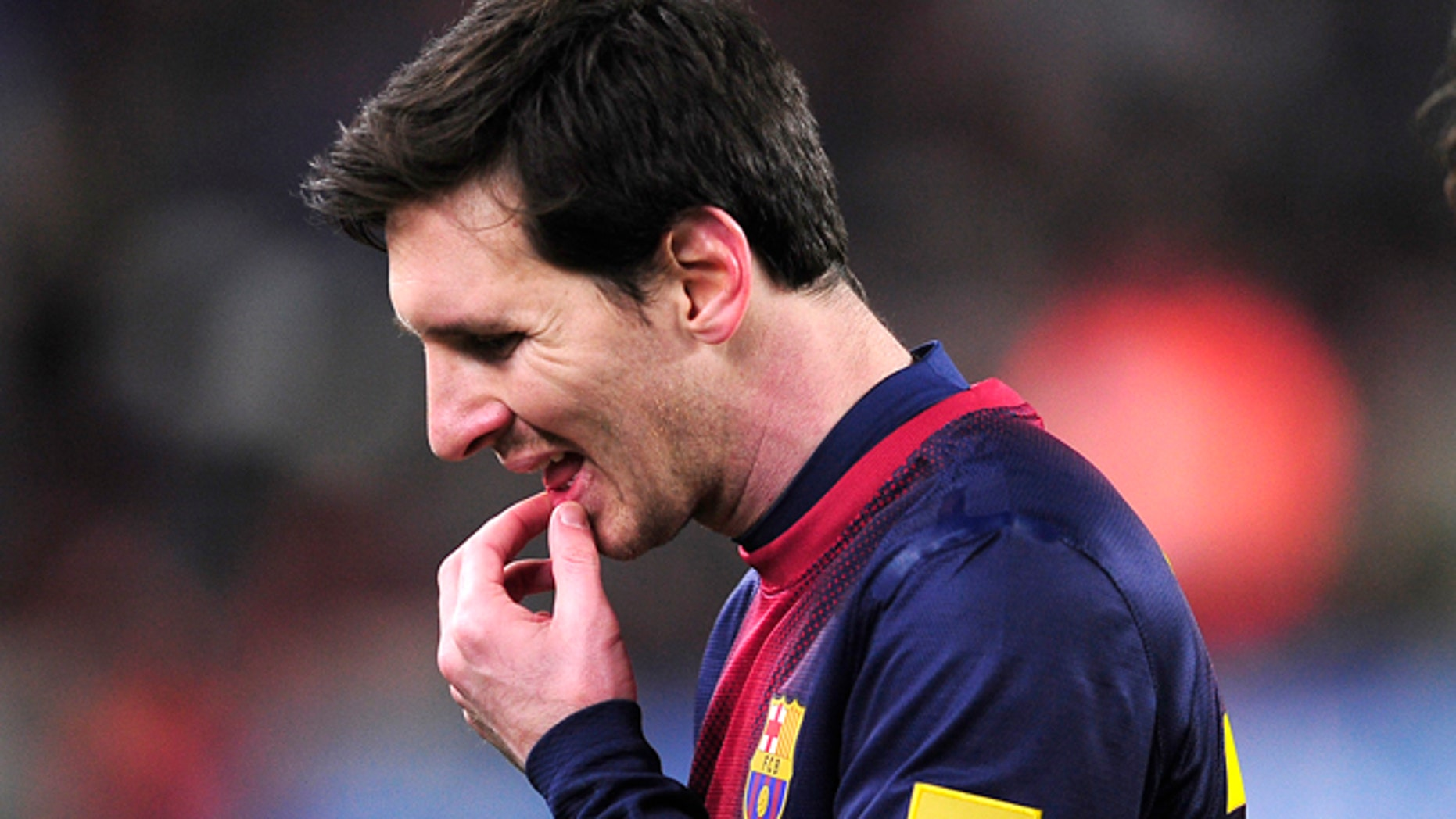 FILE - In this Feb. 26, 2013 file photo, Barcelona's Lionel Messi from Argentina reacts after losing the Copa del Rey soccer match between FC Barcelona and Real Madrid at the Camp Nou stadium in Barcelona, Spain. A state prosecutor for the northeastern region of Catalonia has lodged on Wednesday June 12, 2013, a lawsuit against Lionel Messi for fraud in unpaid income tax amounting to euro4 million ($5.3 million). The complaint, signed by prosecutor Raquel Amado, has been submitted for trial at the courthouse in Gava, the upscale Barcelona district where the Argentina forward lives. The document, presented to the court on Wednesday, brings a lawsuit against Barcelona star Messi and his father, Jorge Horacio Messi.(AP Photo/Manu Fernandez, File)