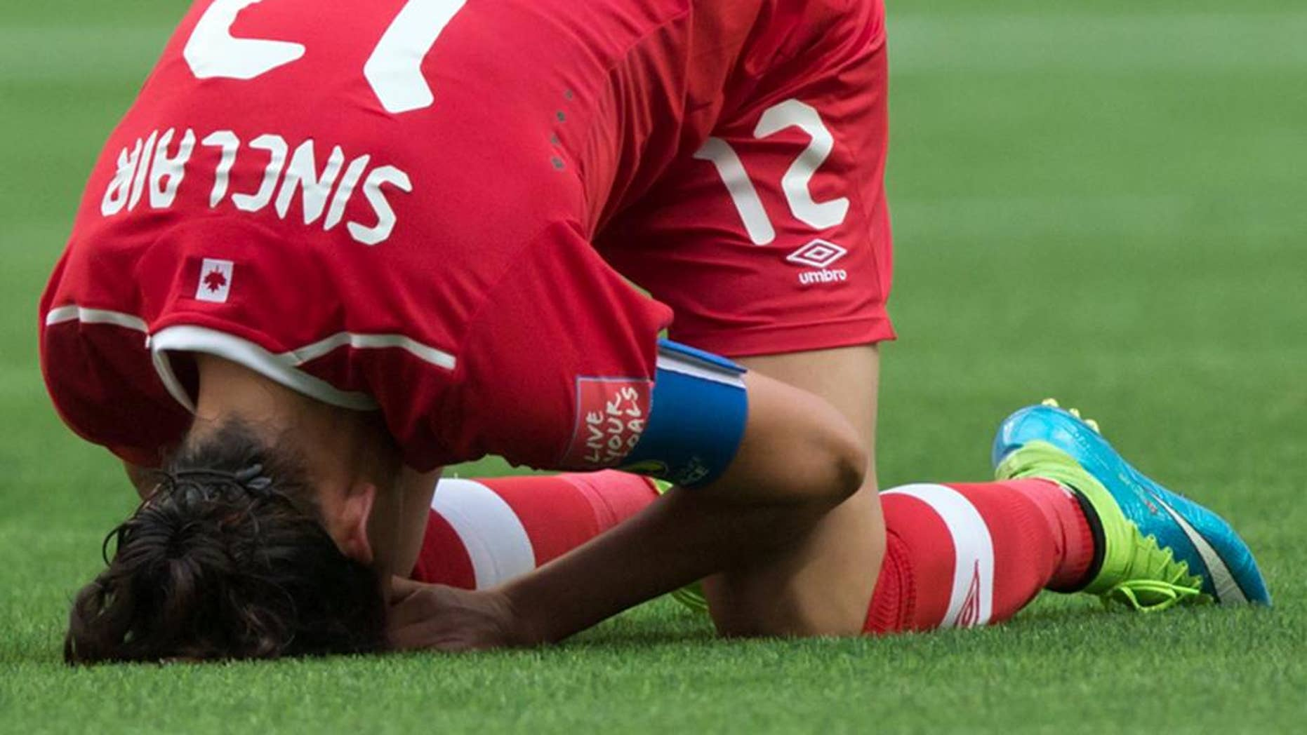 Canada's Christine Sinclair reacts after losing 2-1 to England during a FIFA Women's World Cup quarterfinal soccer game in Vancouver, British Columbia, Canada, on Saturday, June 27, 2015. (Darryl Dyck/The Canadian Press via AP) MANDATORY CREDIT