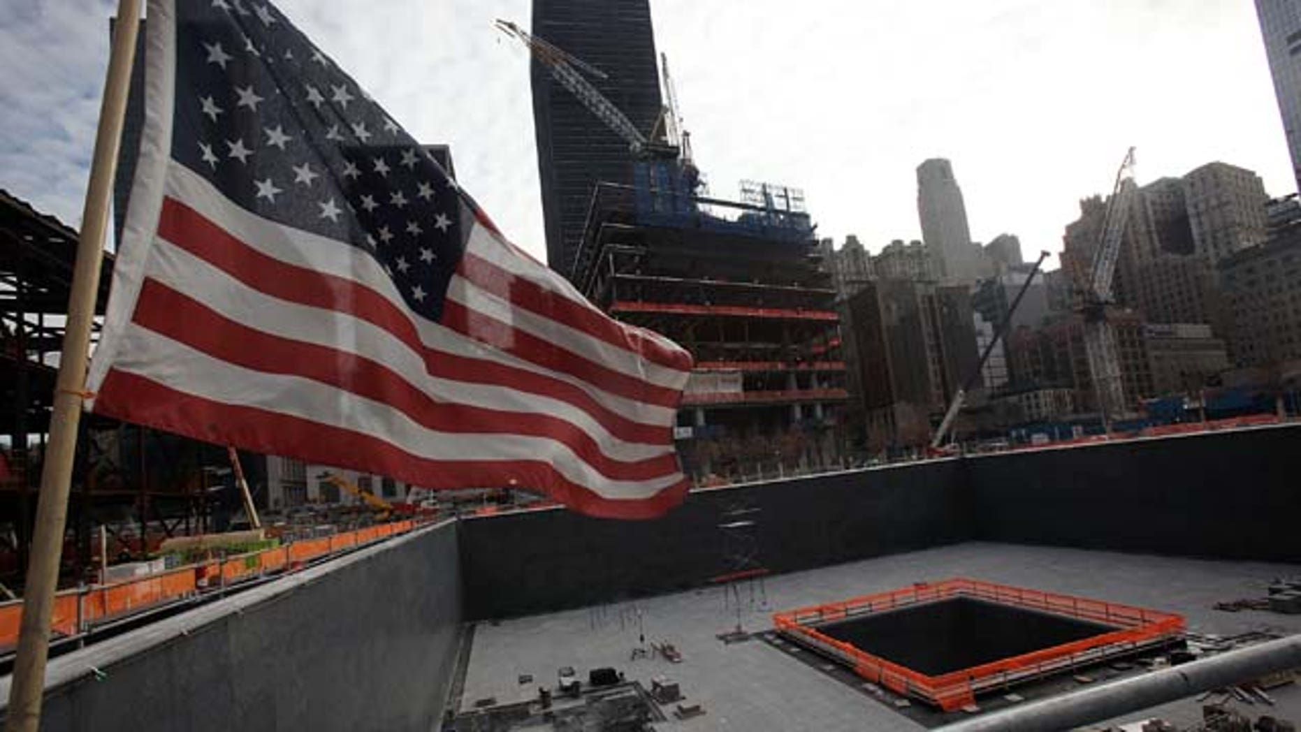 """One of the memorial pools is seen after a ceremonial planting of the so-called """"Survivor Tree"""" at the 9/11 Memorial area of the World Trade Center site in New York City."""