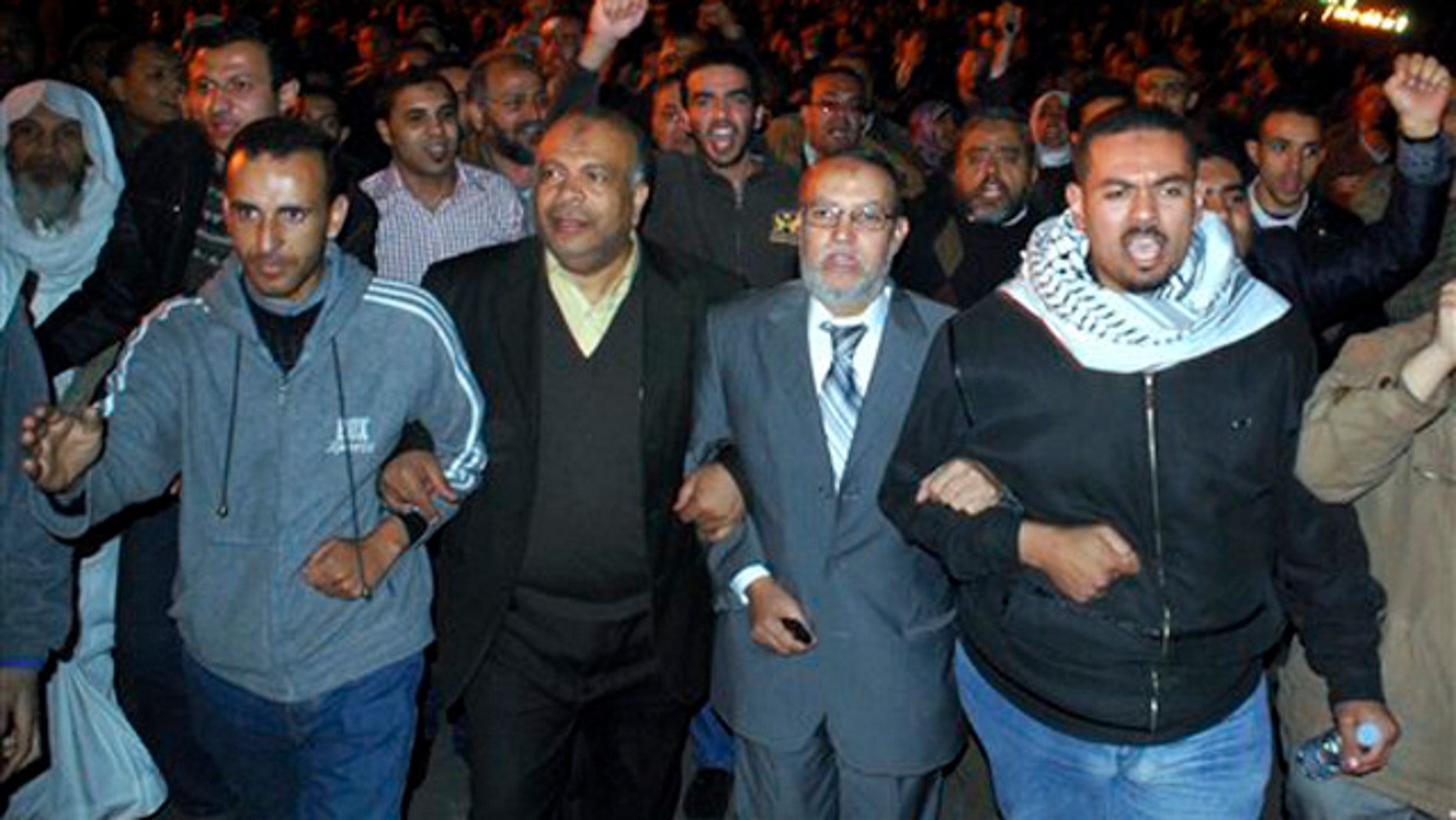 Jan. 30, 2011: Egyptian Brotherhood seniors Essam el-Erian, center right, and Saad el-Katatni, center left, take part in a protest in Cairo, Egypt.