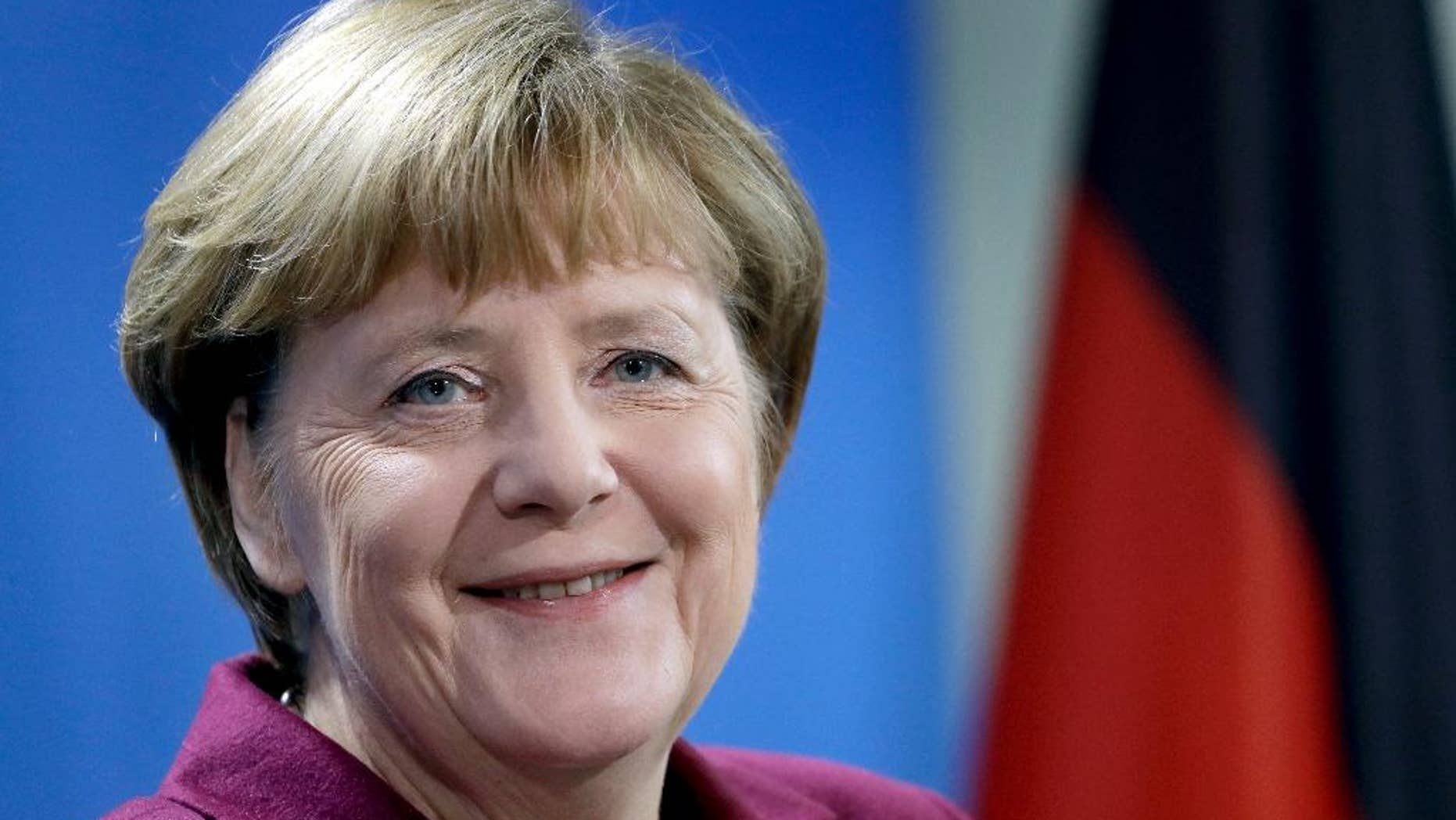FILE - In this Nov. 8, 2016 file photo German Chancellor Angela Merkel smiles during a joint news conference as part of a meeting with the Prime Minister of Norway, Erna Solberg, at the chancellery in Berlin, Germany. (AP Photo/Michael Sohn, file)