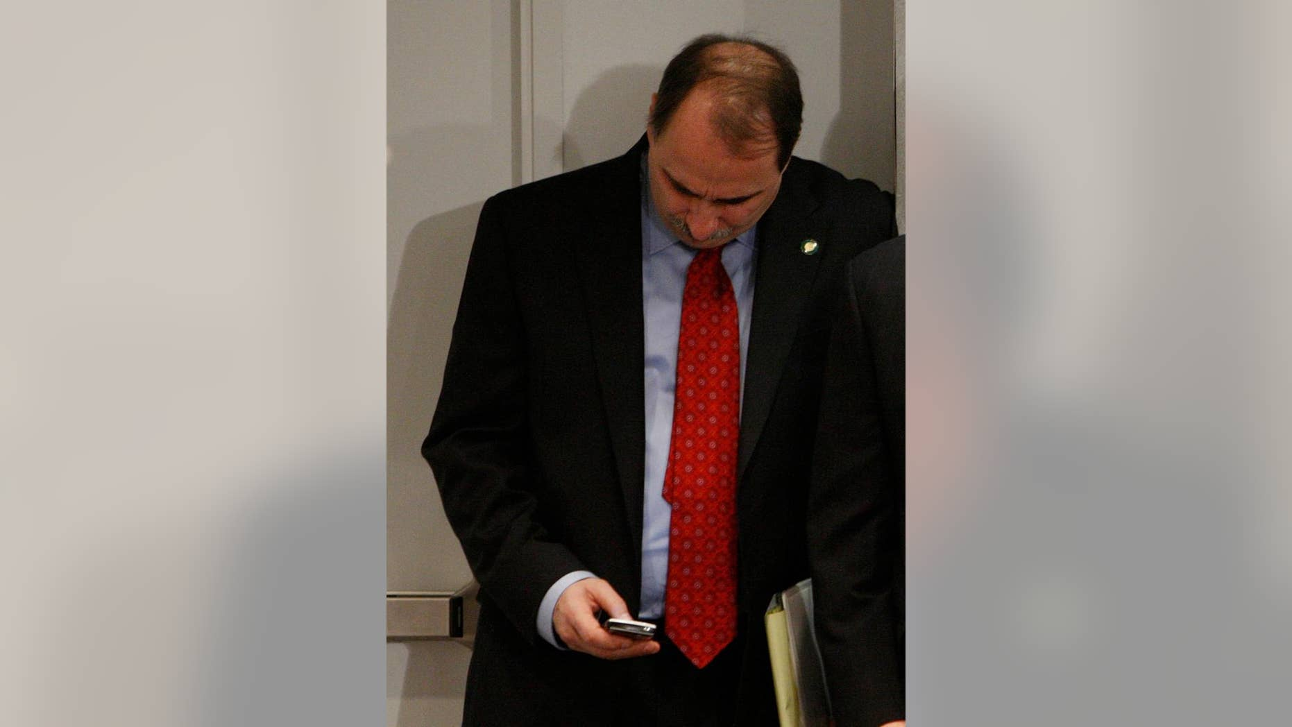 In this Jan. 9, 2009 file photo, David Axelrod checks his BlackBerry E-Mail device at the White House (AP Photo/Charles Dharapak. File)