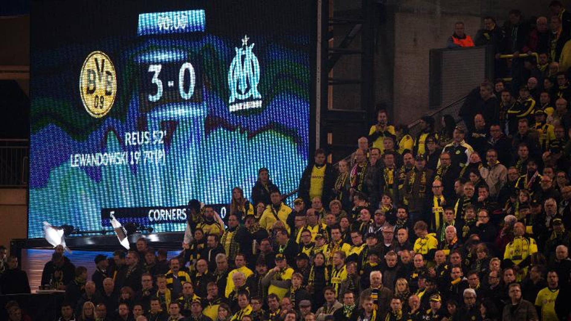 An electronic billboard shows the final score after the UEFA Champions League Group F football match Borussia Dortmund vs Olympique Marseille in Dortmund, western Germany on October 1, 2013