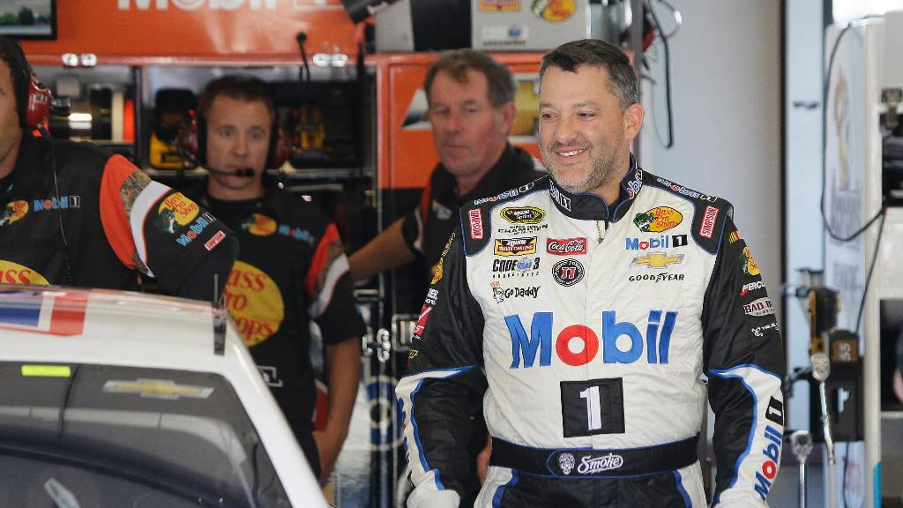 Tony Stewart walks to his car during practice for the NASCAR Sprint Cup Series auto race Friday, June 26, 2015, in Sonoma, Calif. (AP Photo/Eric Risberg)