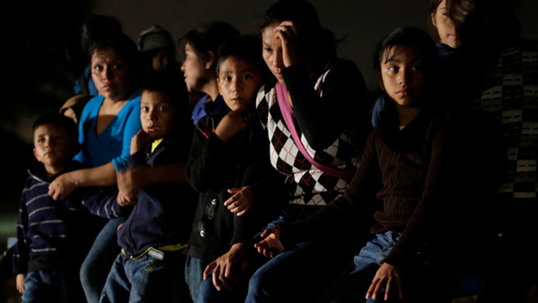 Group of  immigrants from Honduras and El Salvador are stopped in Granjeno, Texas, on June 25, 2014.