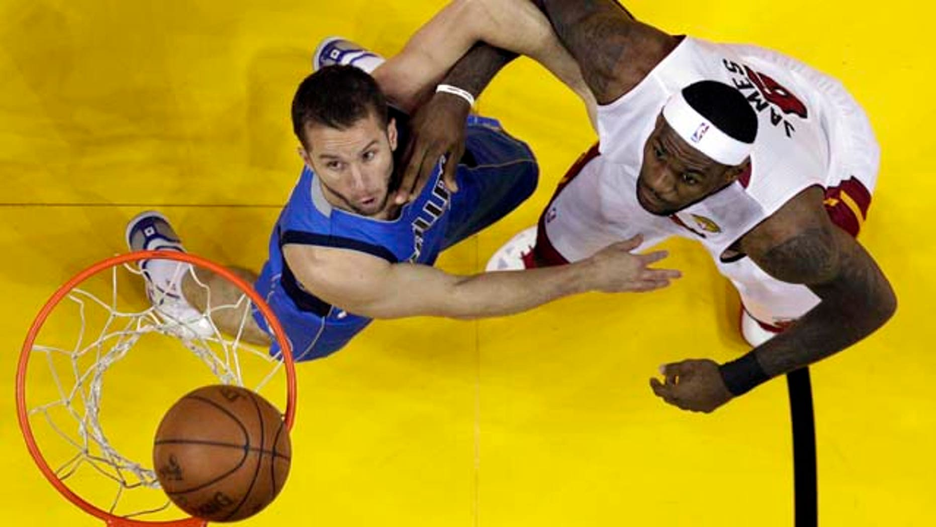 baab5e4af749d Miami Heat's LeBron James (6) and Dallas Mavericks' Jose Juan Barea battle  for