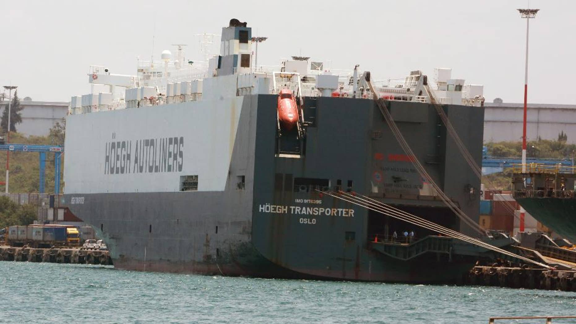 In this photo taken on Friday, Sept. 25, 2015, the Norwegian flagged Hoegh Autoliners cargo ship is photographed at the port of Mombasa, in Kenya. The Norwegian owner of a ship intercepted in Kenya says the vessel has been set free and allowed to its voyage to South Africa, West Africa and Mexico.  Hoegh Autoliners said in a statement seen Sunday that, after a delay of more than a week, no crew have been arrested. No illegal drugs were found, it added.  (AP Photo)