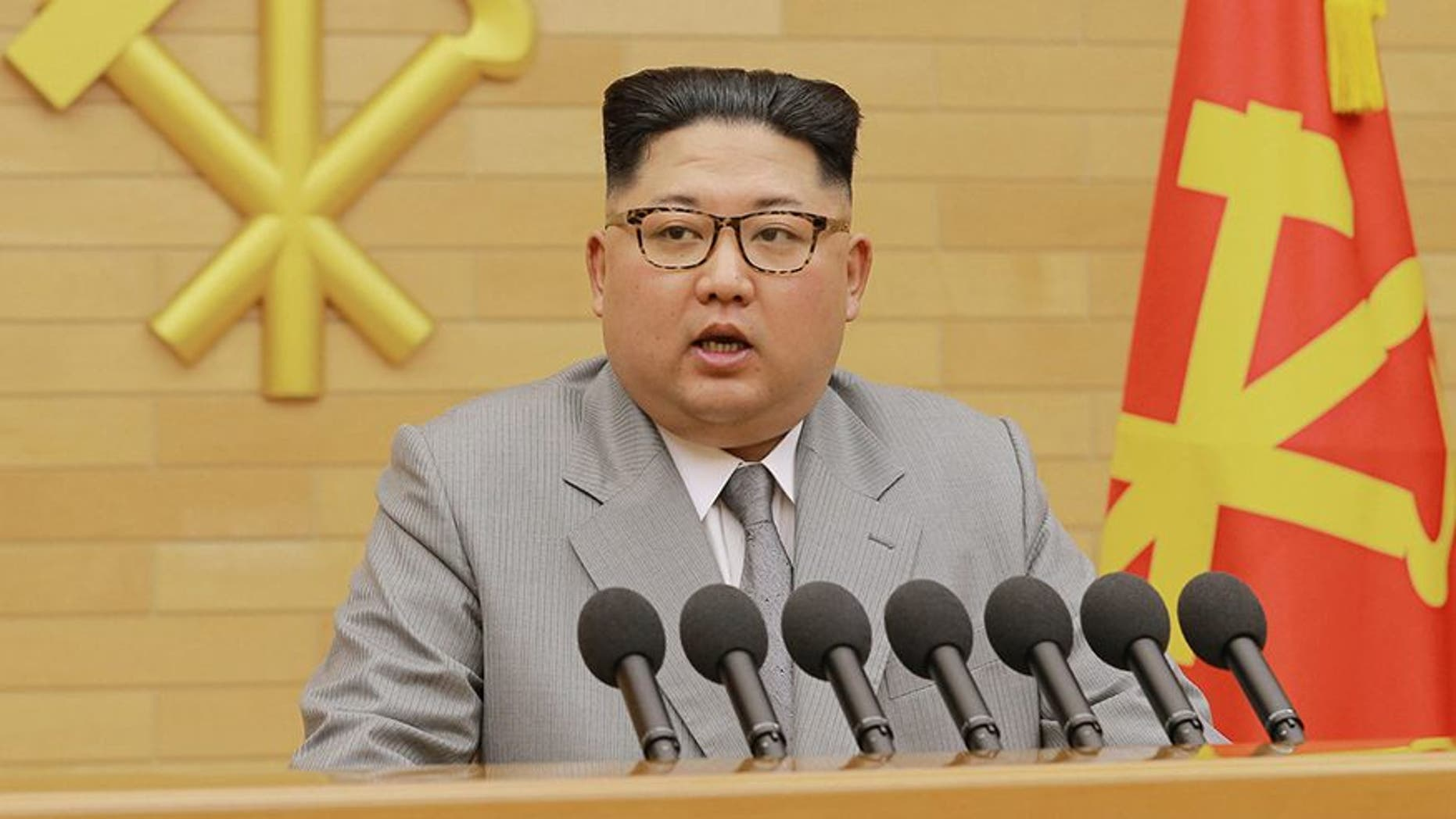 """In this photo provided by the North Korean government, North Korean leader Kim Jong Un delivers his New Year's speech at an undisclosed place in North Korea Monday, Jan. 1, 2018. Kim said Monday the United States should be aware that his country's nuclear forces are now a reality, not a threat. Independent journalists were not given access to cover the event depicted in this image distributed by the North Korean government. The content of this image is as provided and cannot be independently verified. Korean language watermark on image as provided by source reads: """"KCNA"""" which is the abbreviation for Korean Central News Agency. (Korean Central News Agency/Korea News Service via AP)"""