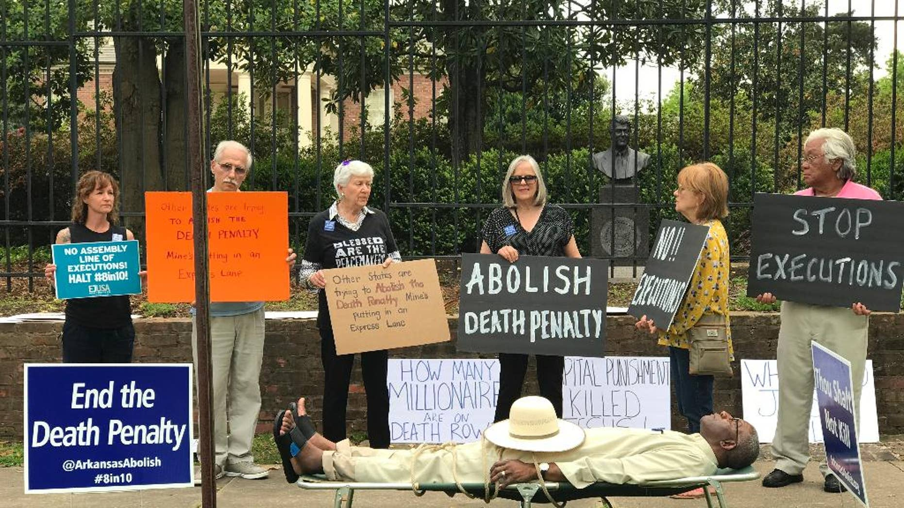 FILE - In this April 14, 2017, file photo provided by Sherry Simon, Pulaski County Circuit Judge Wendell Griffen, is shown on a cot at an anti-death penalty protest outside the Governor's Mansion in Little Rock, Ark. Griffen said Thursday, April 26, 2017, he was not given a chance to explain his actions before being removed from death penalty-related cases. He asked two state panels to investigate the attorney general's office and the state Supreme Court over his removal. (Sherry Simon via AP, File)
