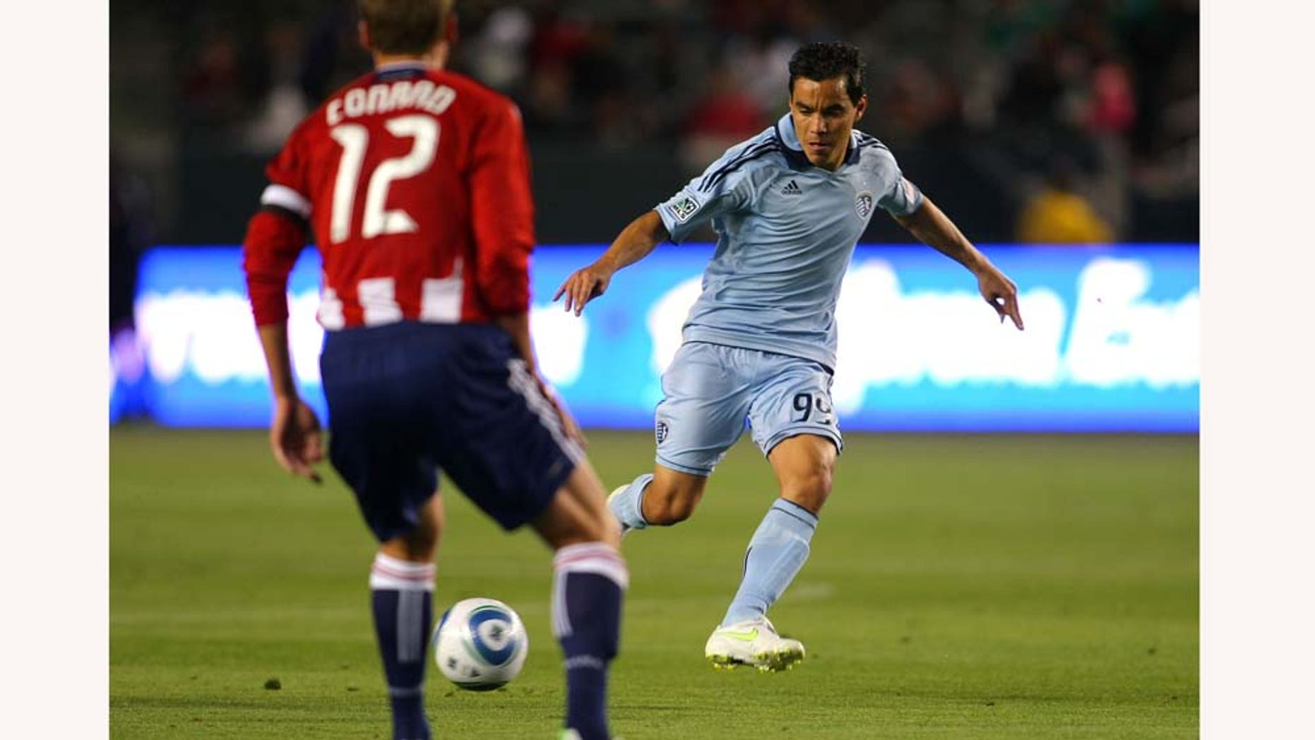 CARSON, CA - MARCH 19:  Omar Bravo #99 of Sporting Kansas City passes the ball in the first half during the MLS match against Chivas USA at The Home Depot Center on March 19, 2011 in Carson, California. SKC defeated Chivas USA 3-2. (Photo by Victor Decolongon/Getty Images)