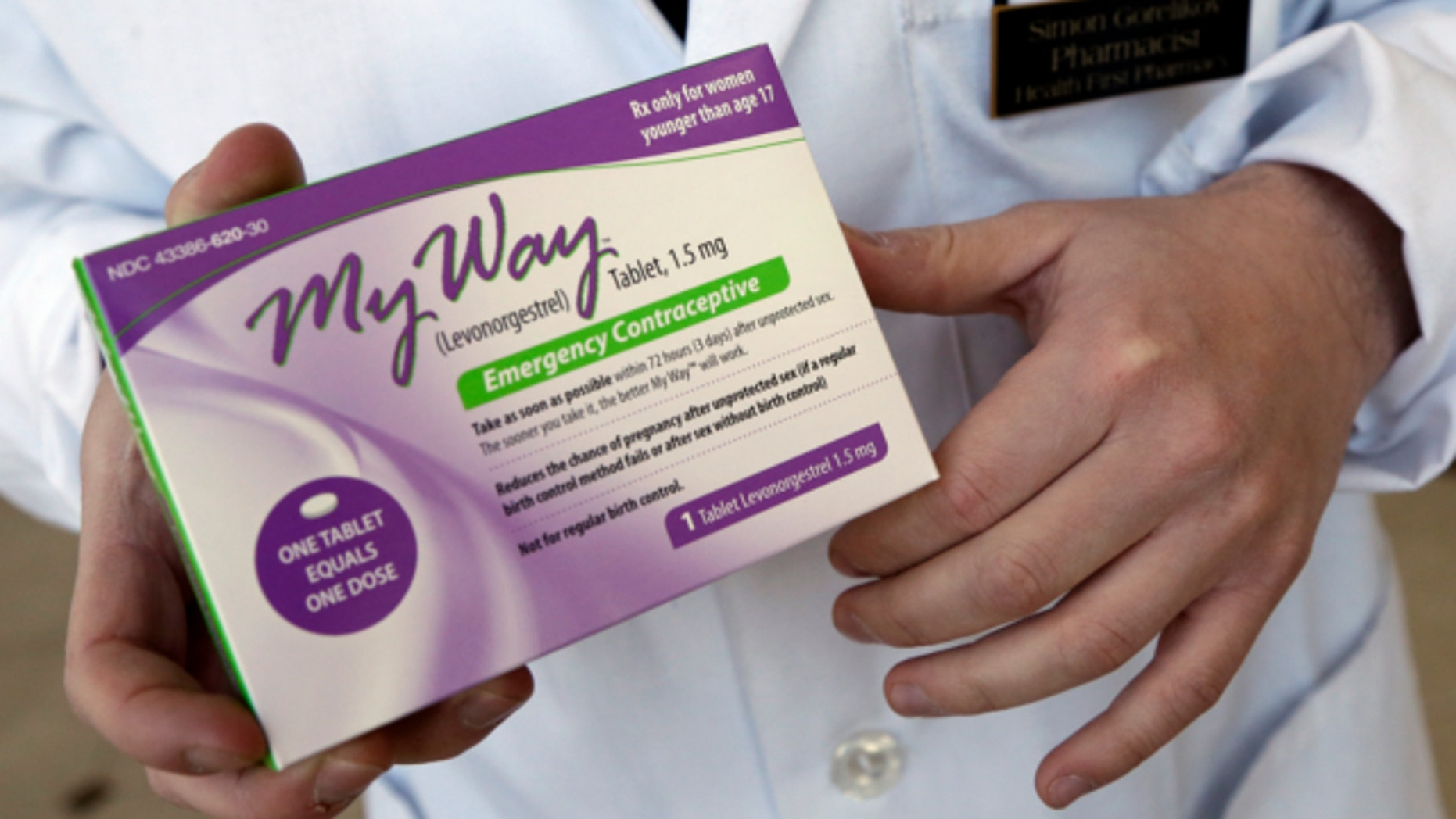 May 2, 2013: Pharmacist Simon Gorelikov holds a generic emergency contraceptive, also called the morning-after pill, at the Health First Pharmacy in Boston.