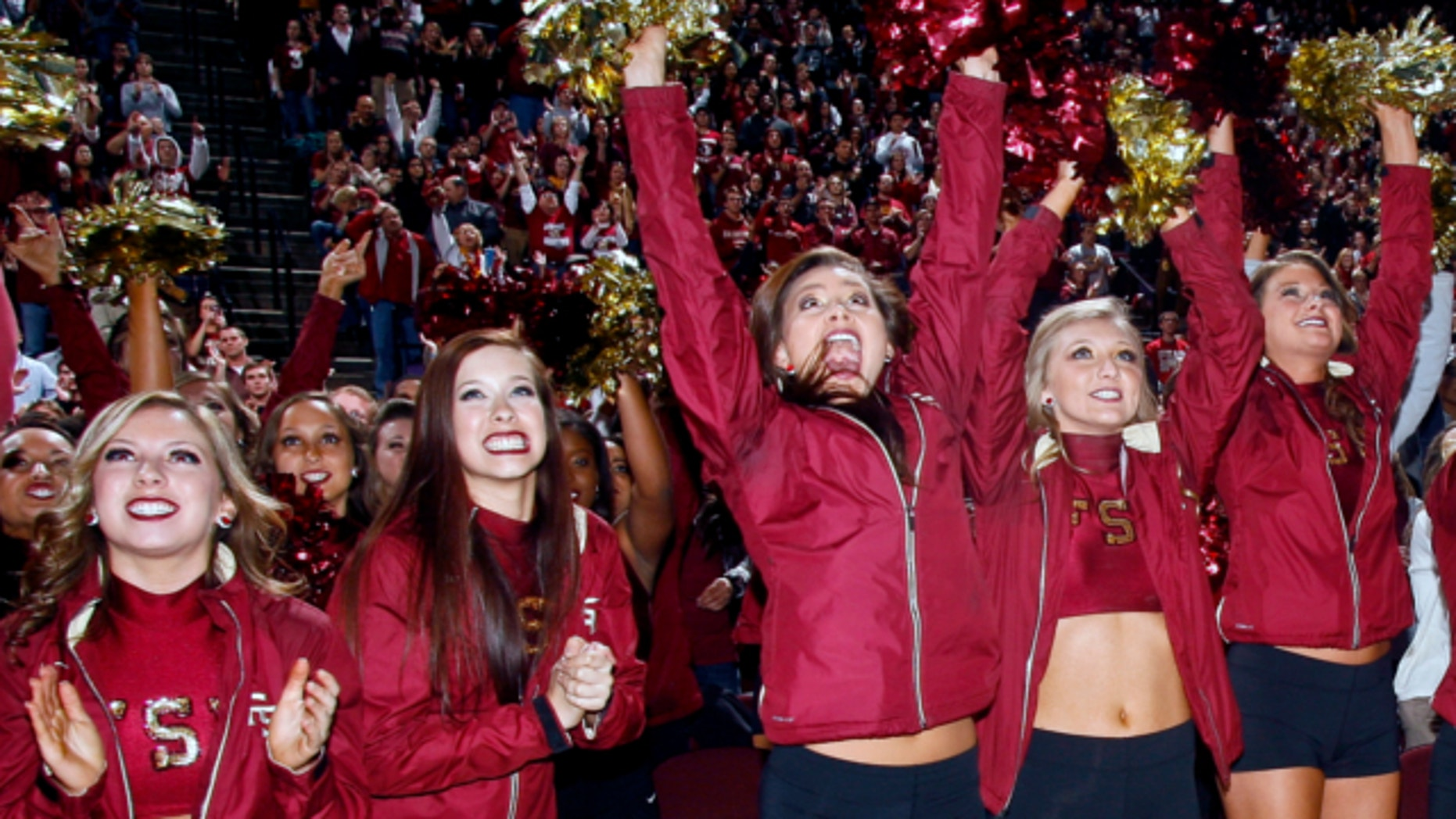 Jan. 6, 2014: Florida State Golden Girls cheerleaders react as they watch Florida State score a touchdown on a 30-foot screen at the Tallahassee Leon County Civic Center in Tallahassee, Fla. in the second quarter of the NCAA BCS National Championship college football game against Auburn.