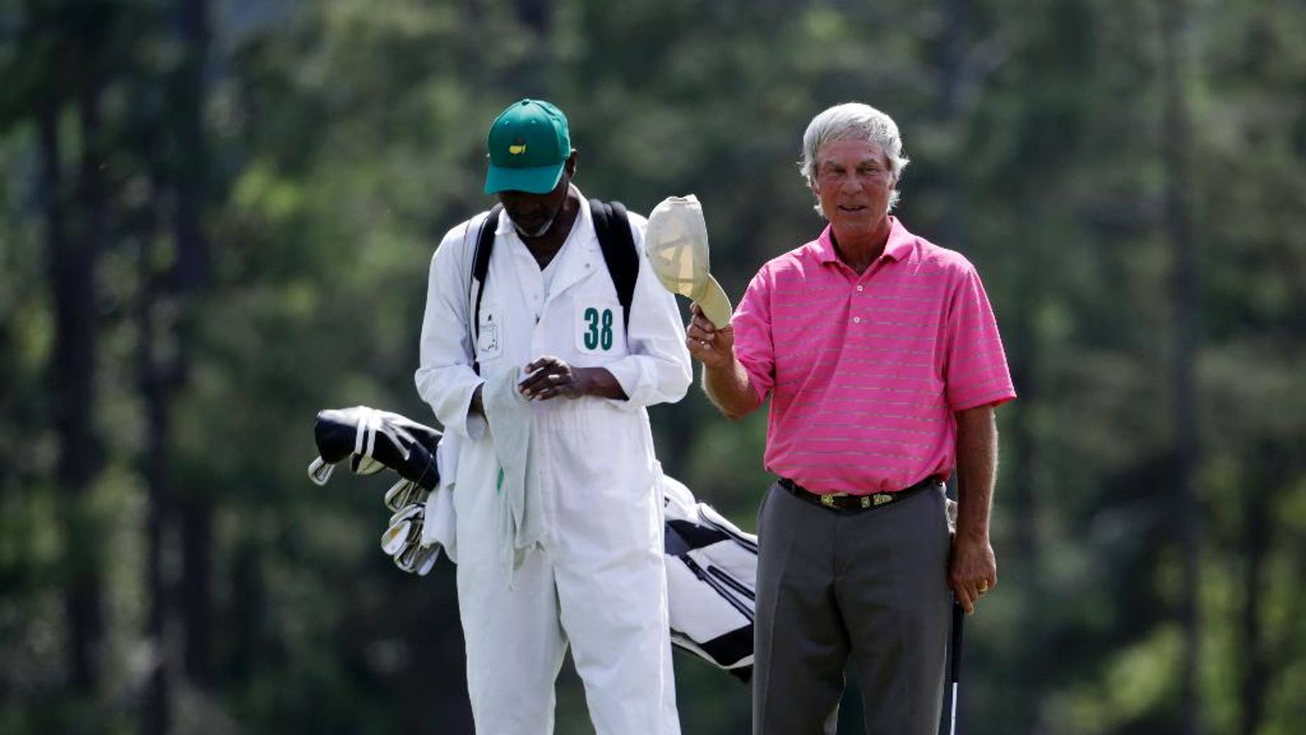 Ben Crenshaw acknowledges applause on the 18th hole during the first round of the Masters golf tournament Thursday, April 9, 2015, in Augusta, Ga. (AP Photo/Darron Cummings)