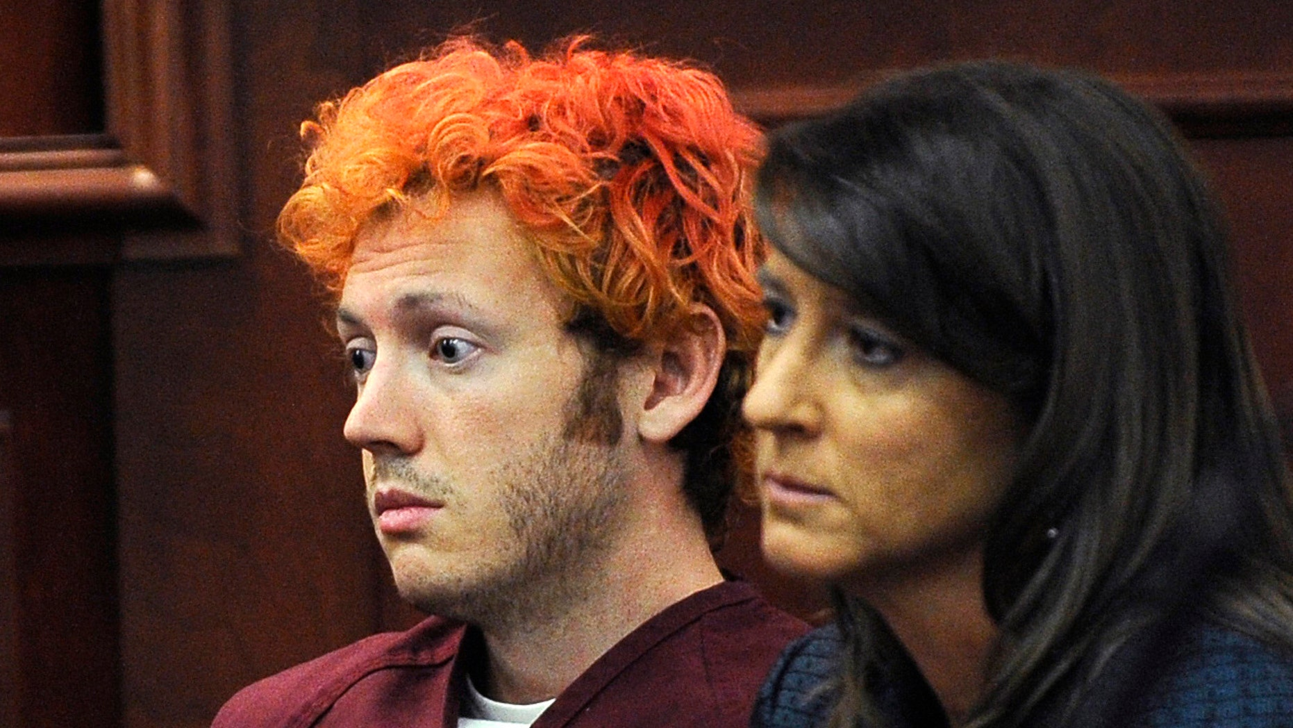 July 23, 2012:  In this file photo, James Holmes, accused of killing 12 people in Friday's shooting rampage in an Aurora, Colo., movie theater, appears in Arapahoe County District Court with defense attorney Tamara Brady in Centennial, Colo.
